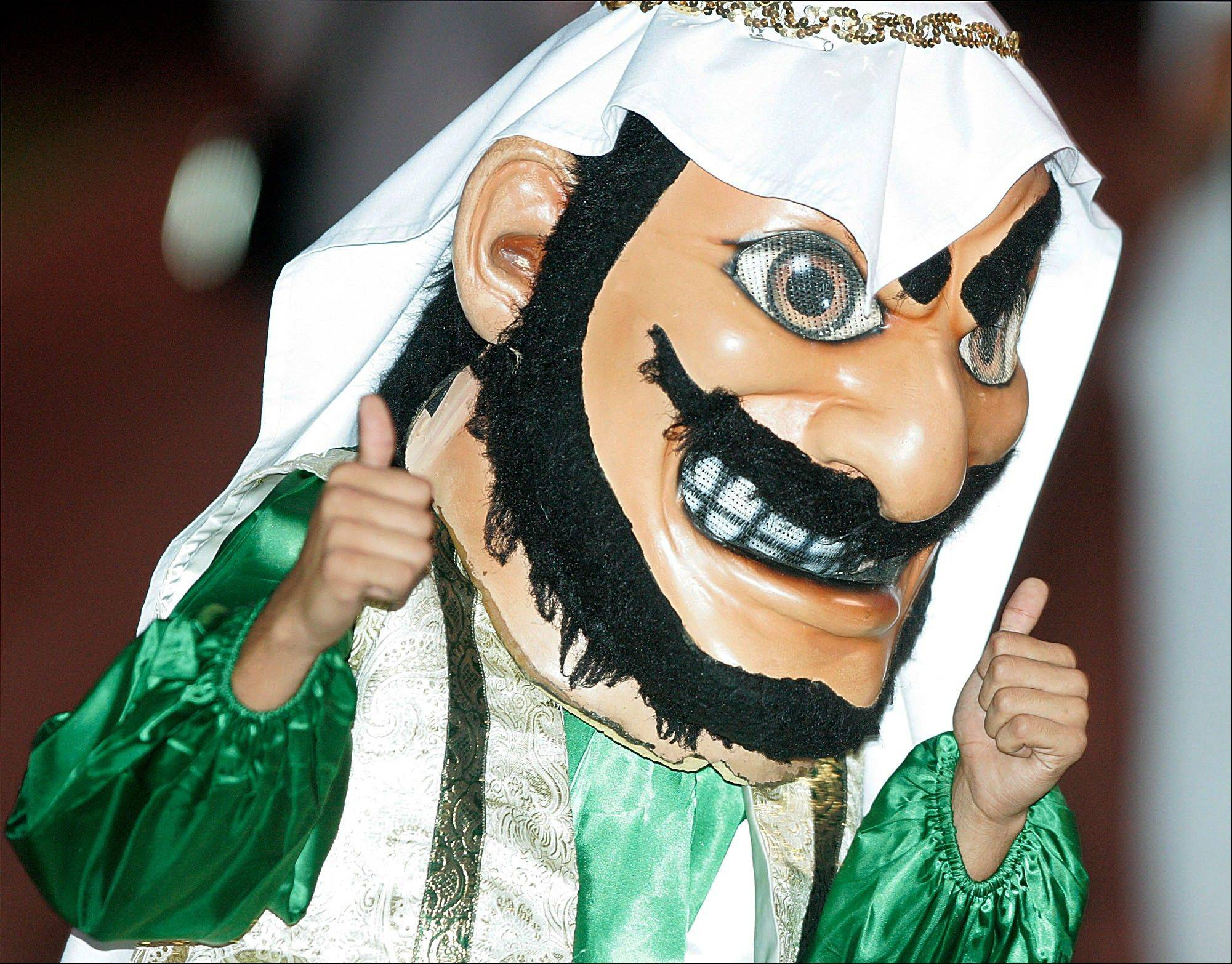 "Coachella Valley High School's mascot, ""Arab,"" gives the thumbs during a game against Yucca Valley, in Thermal, Calif. The American-Arab Anti-Discrimination Committee is calling on the Southern California high school to get rid of its long-standing mascot that it deems offensive. The mascot has been around since the 1920s and was chosen to recognize the area's reliance on date farming, traditionally a Middle Eastern crop."