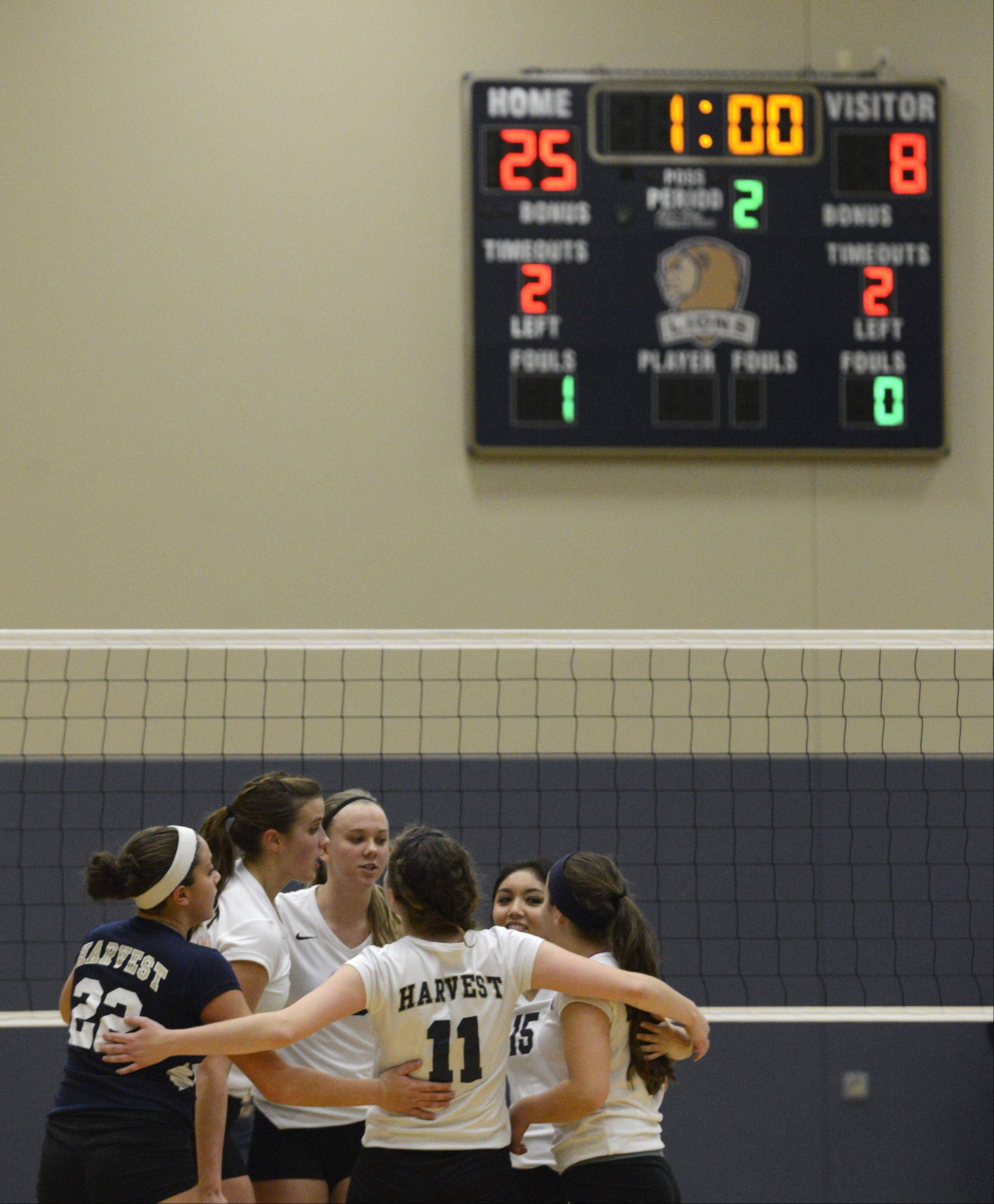 Harvest Christian Academy�s girls volleyball team comes together after beating St. Francis de Sales in two games in the sectional final in Elgin Thursday.