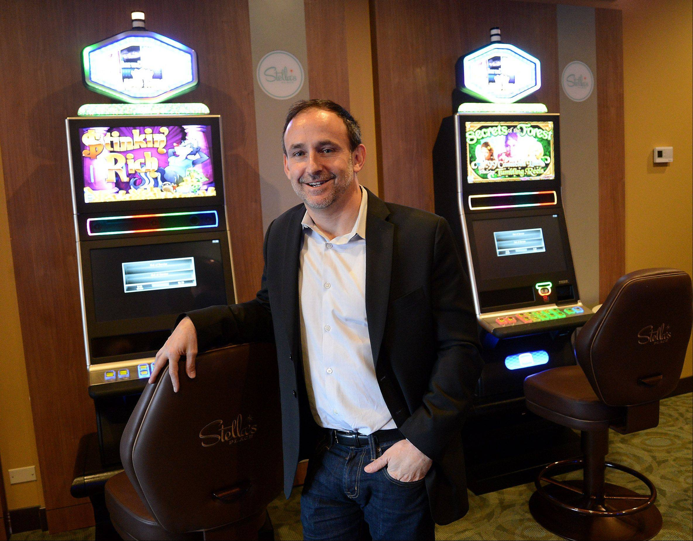 Gary Leff, chief executive officer of Laredo Hospitality, stands by a couple of video gaming machines at Stella's, a new bar that opened in Hoffman Estates Thursday.