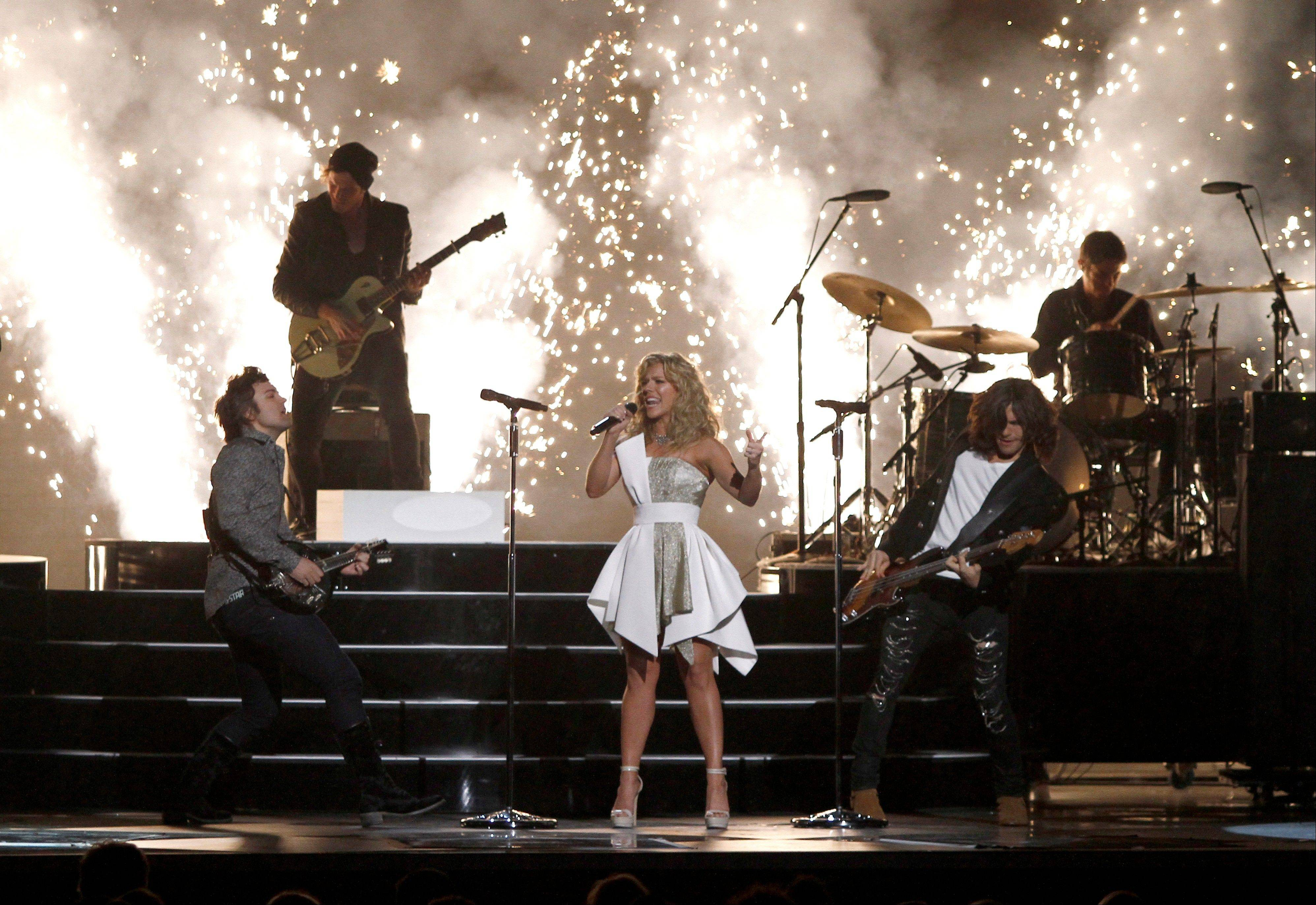 The Band Perry, from front left, Neil, Kimberly and Reid Perry perform