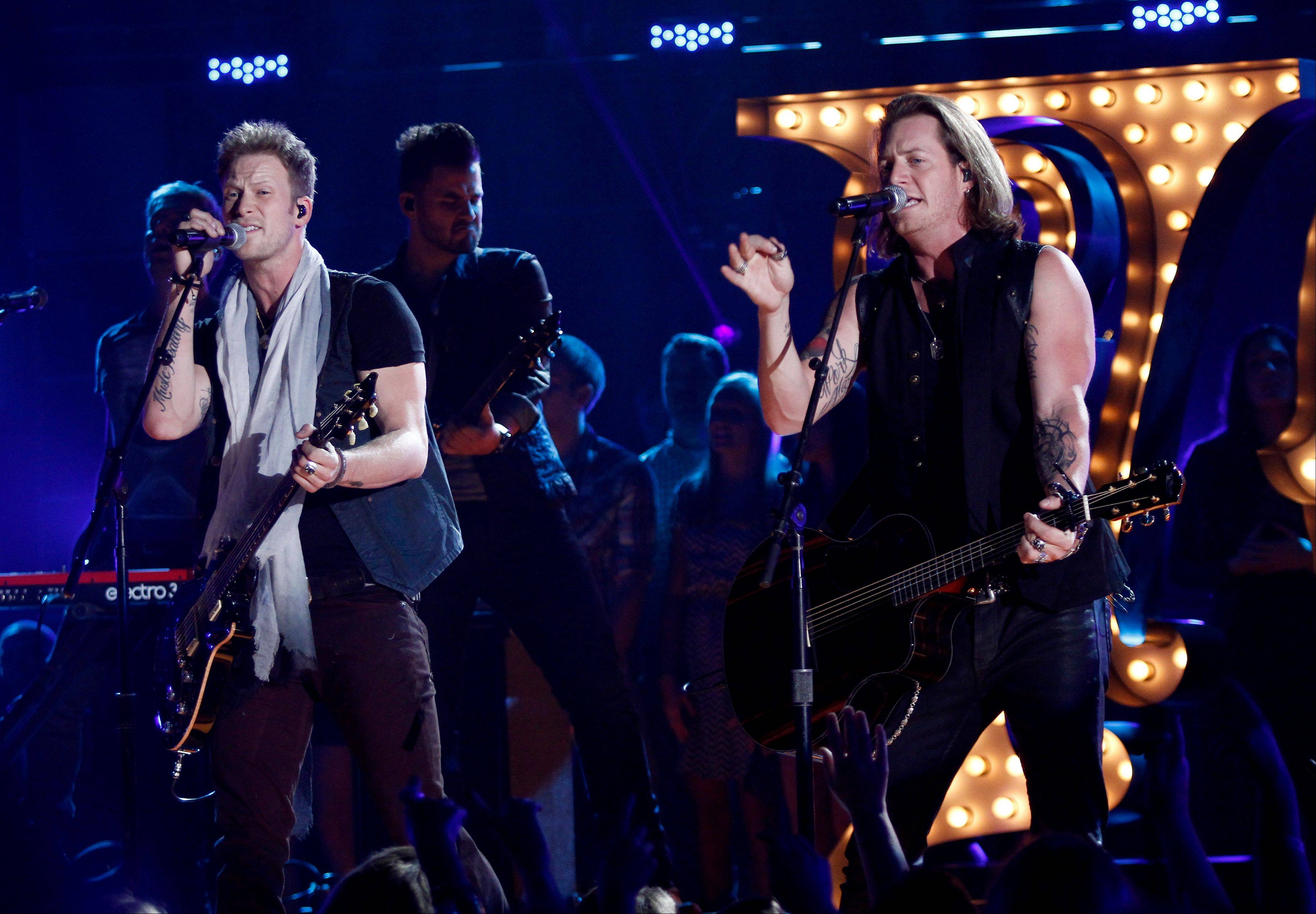 Florida Georgia Line's, Brian Kelley, left, and Tyler Hubbard perform