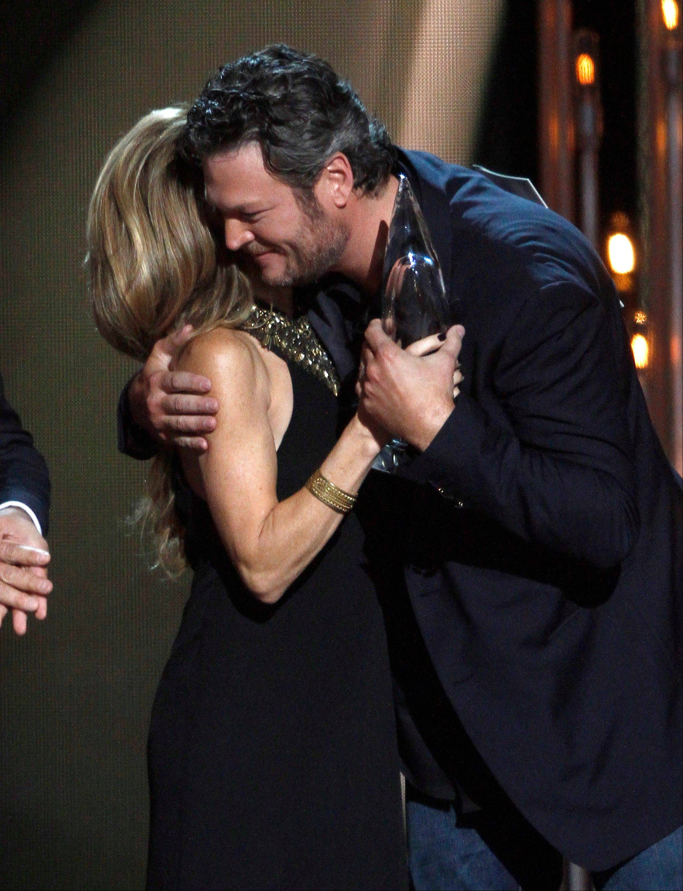 Sheryl Crow, left, presents the award for album of the year to Blake Shelton