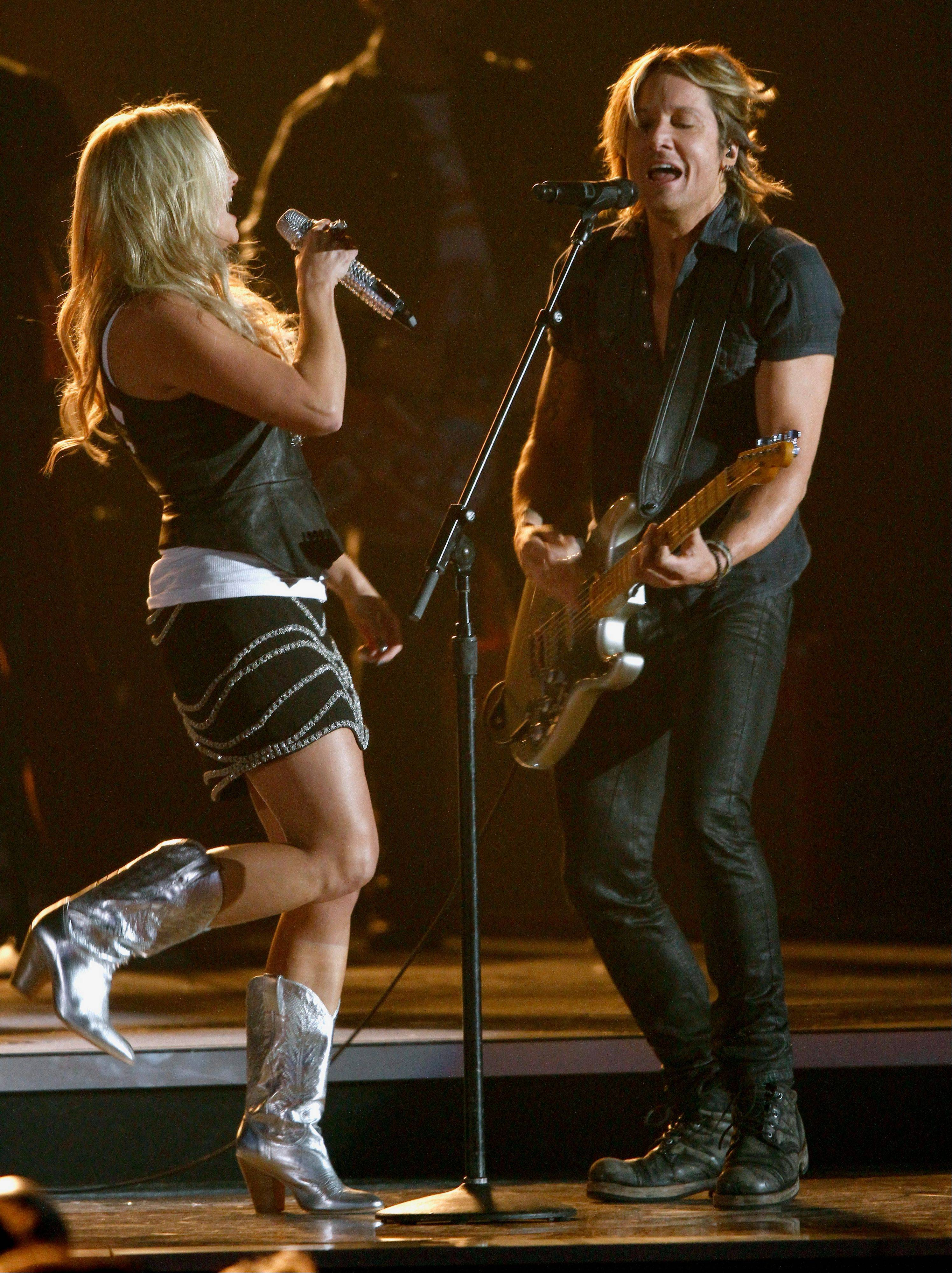 Keith Urban, right, and Miranda Lambert, perform