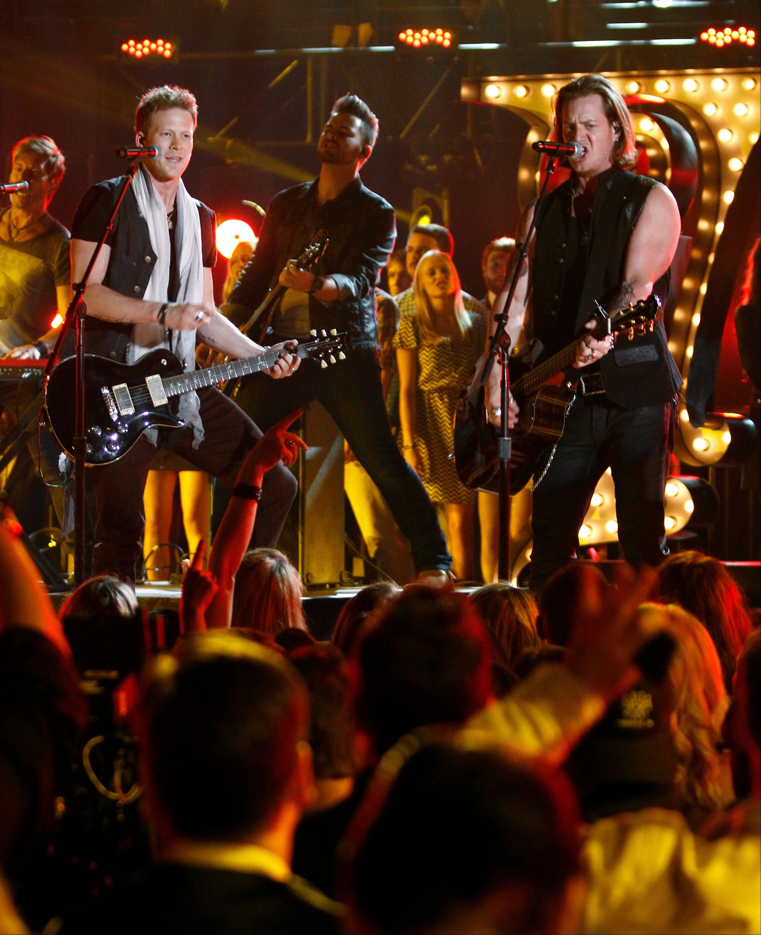 Florida Georgia Line's Brian Kelley, left, and Tyler Hubbard, right, perform