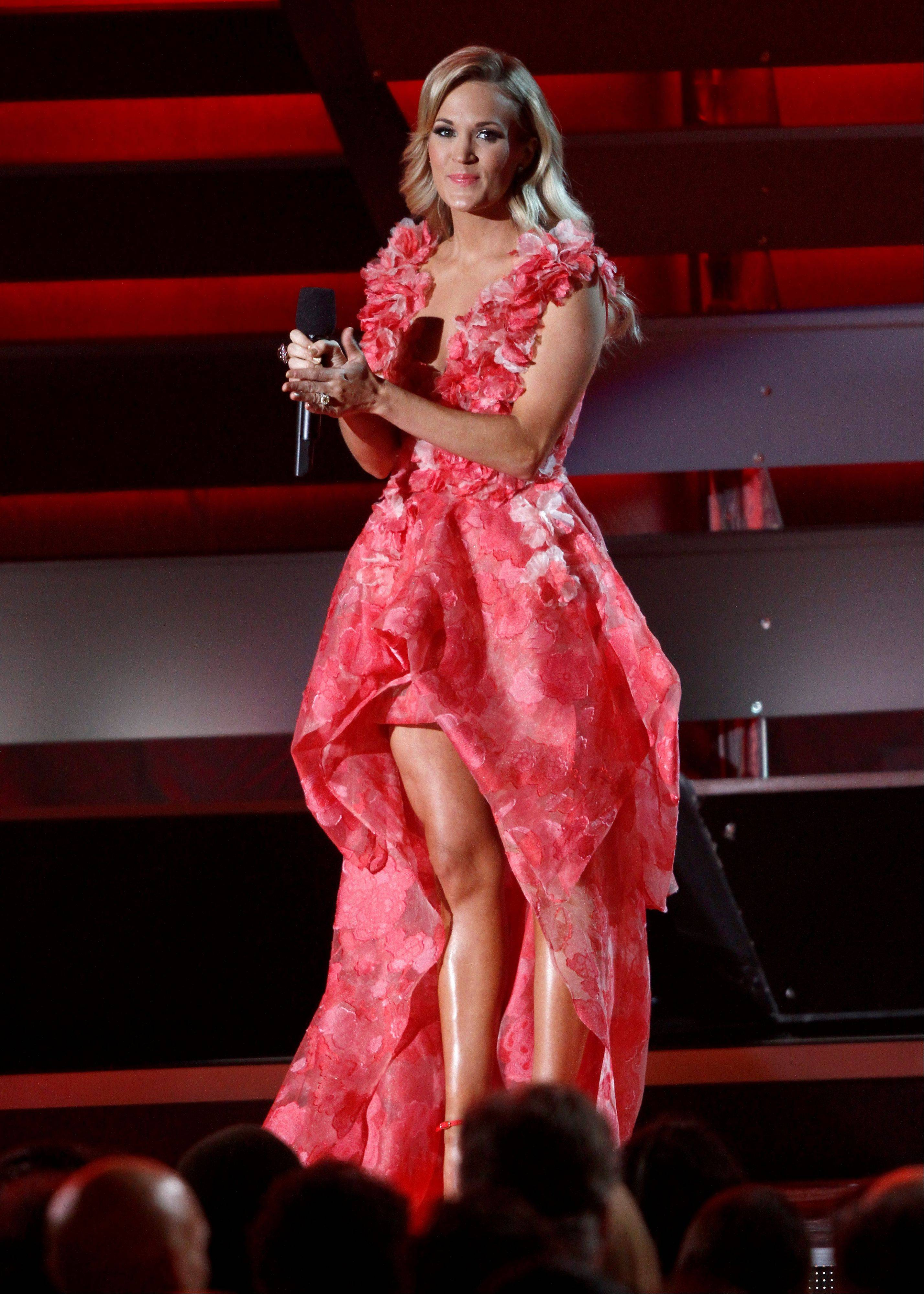 Host Carrie Underwood speaks on stage