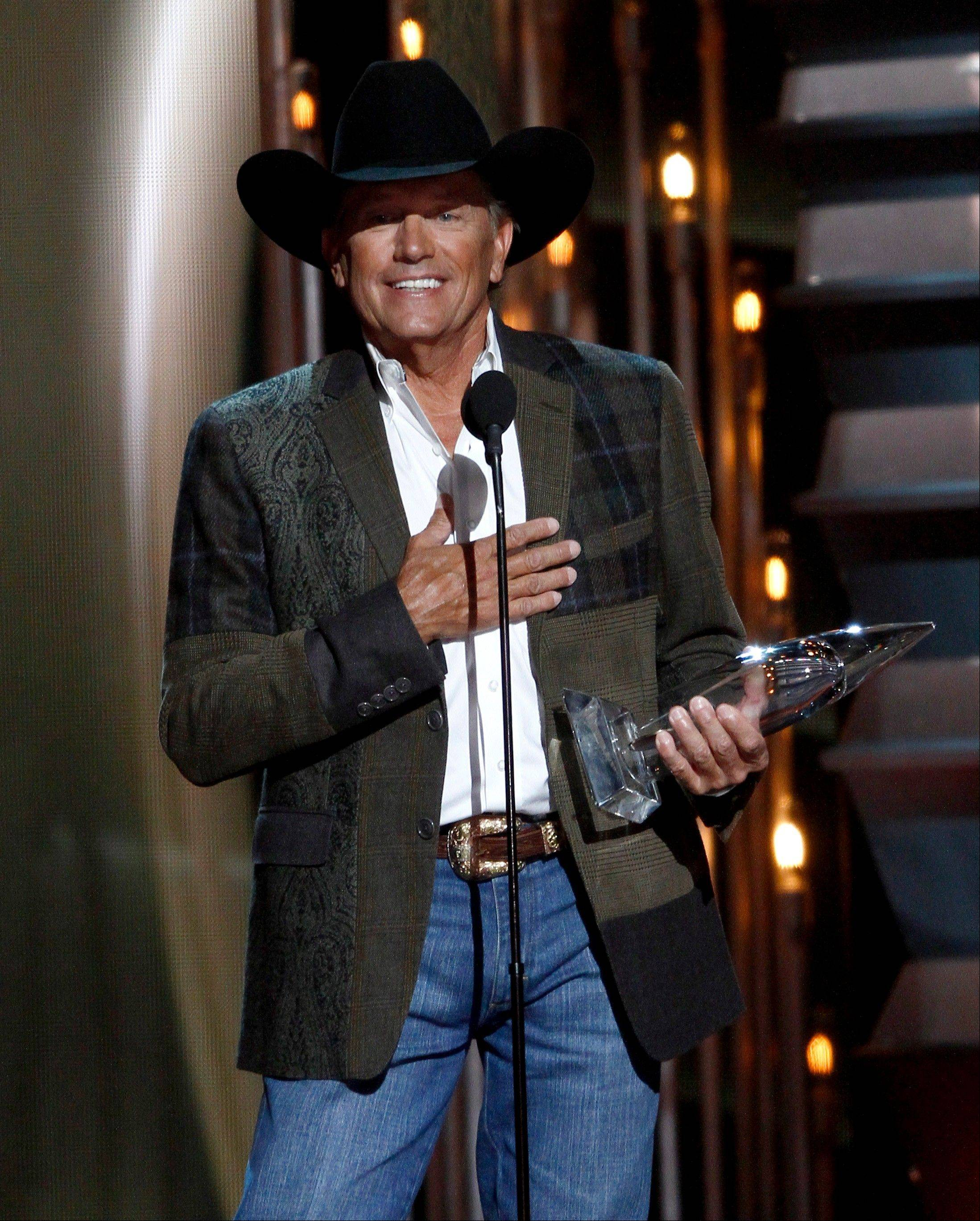 George Strait accepts the award for entertainer of the year.