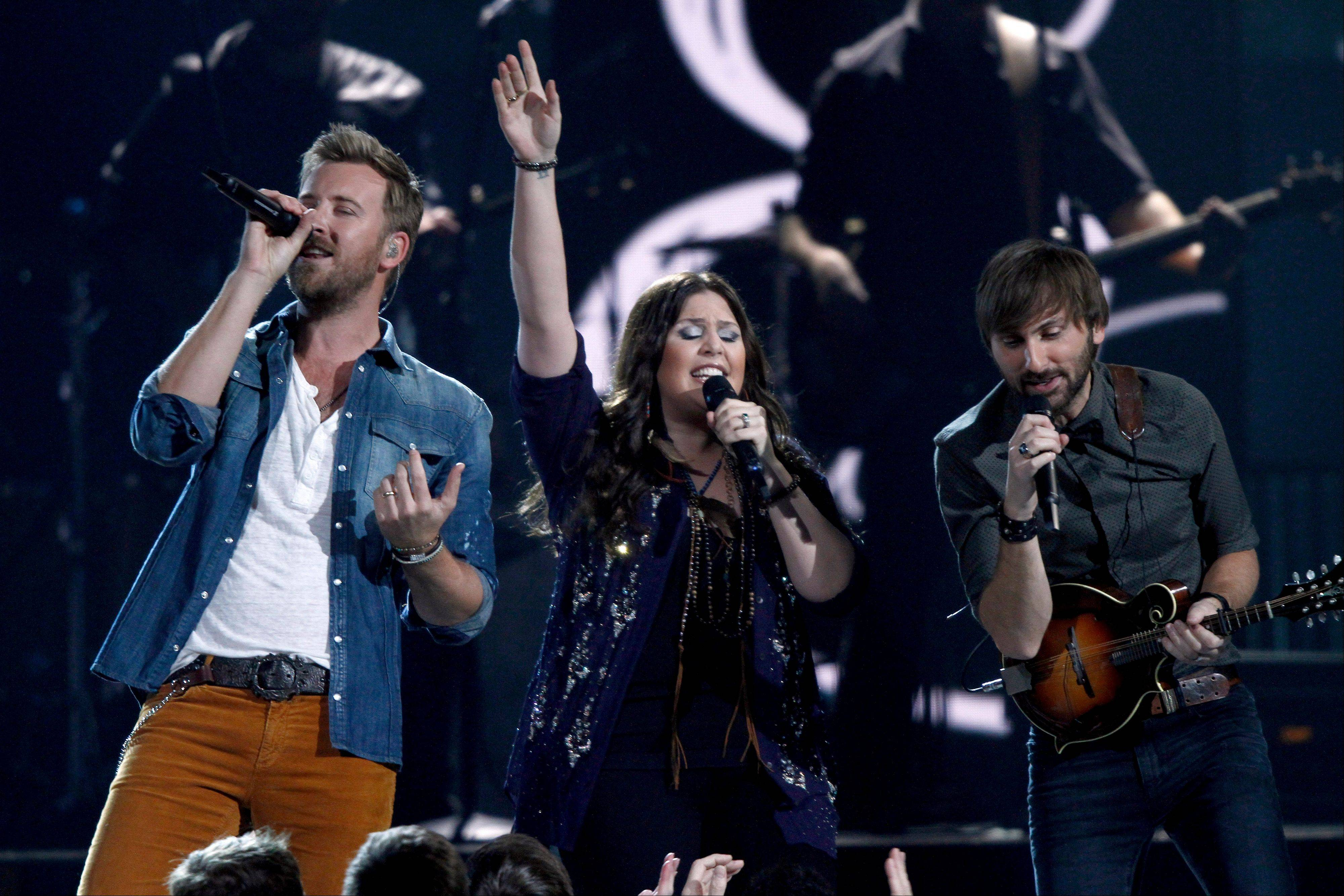 Lady Antbellum, from left, Charles Kelley, Hillary Scott, and Dave Haywood, perform