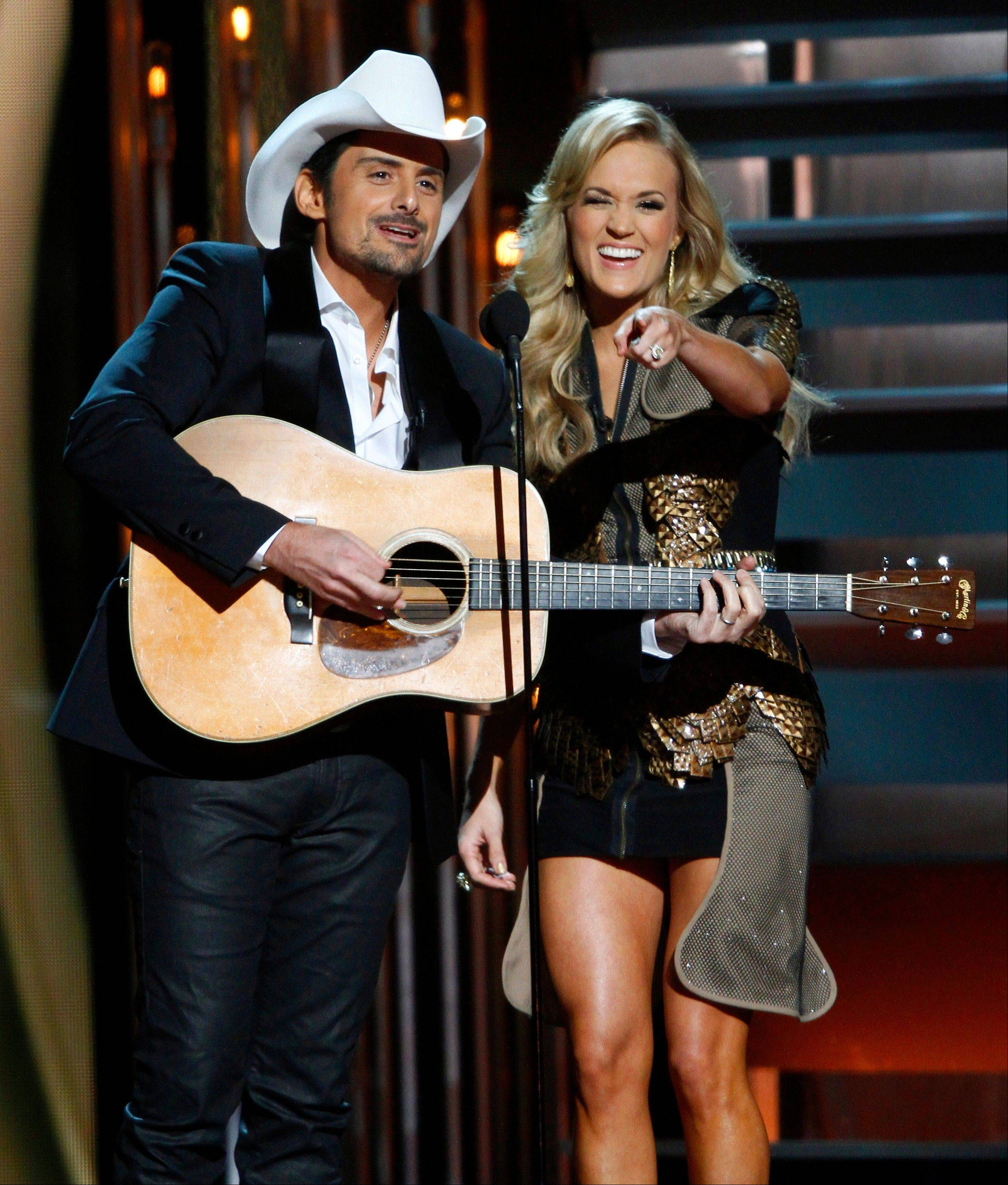 Co-hosts Brad Paisley, left, and Carrie Underwood perform