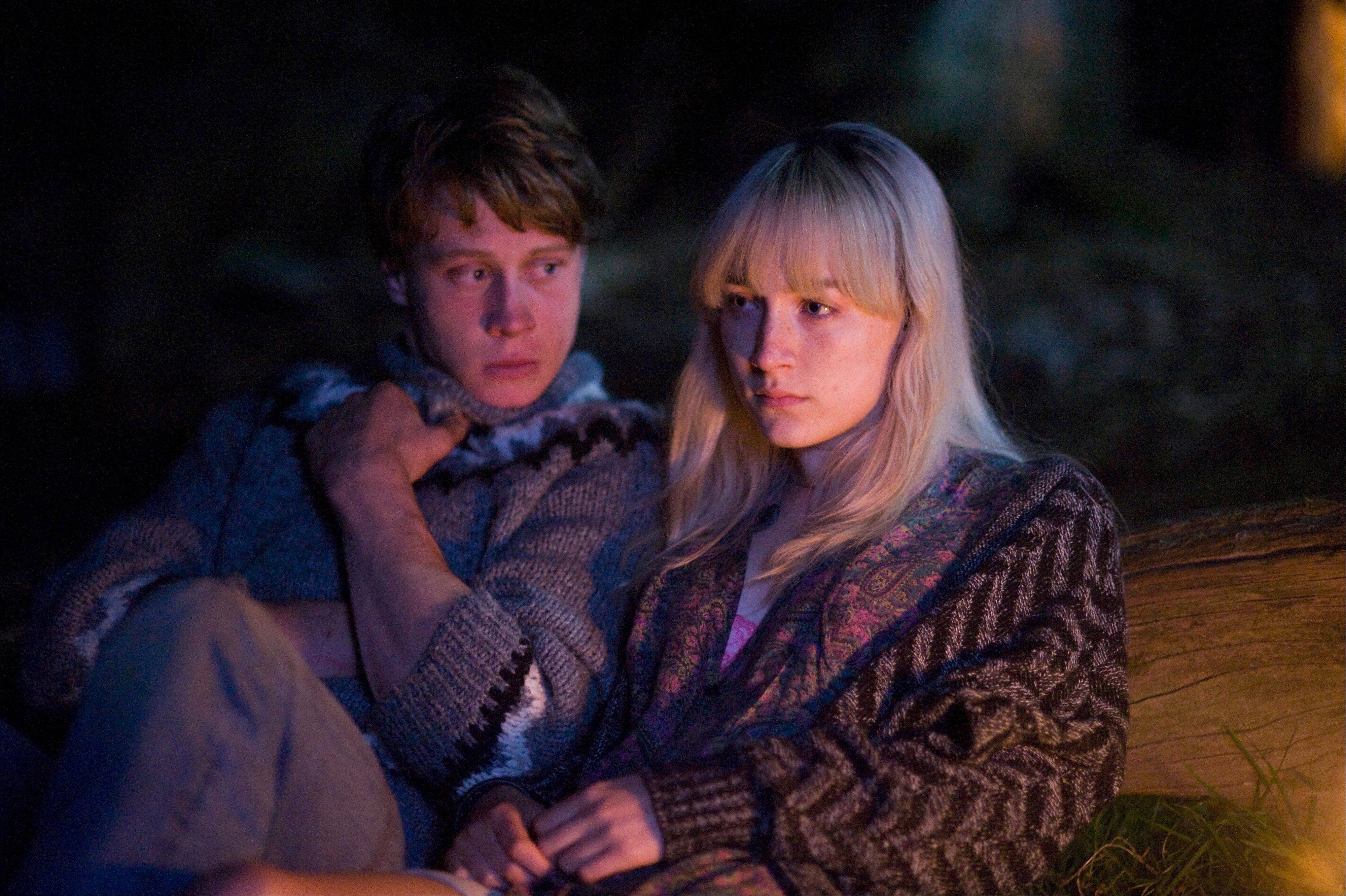 "Eddie (George MacKay) and Daisy (Saoirse Ronan) struggle to survive a nuclear attack on London in the drama ""How I Live Now."""