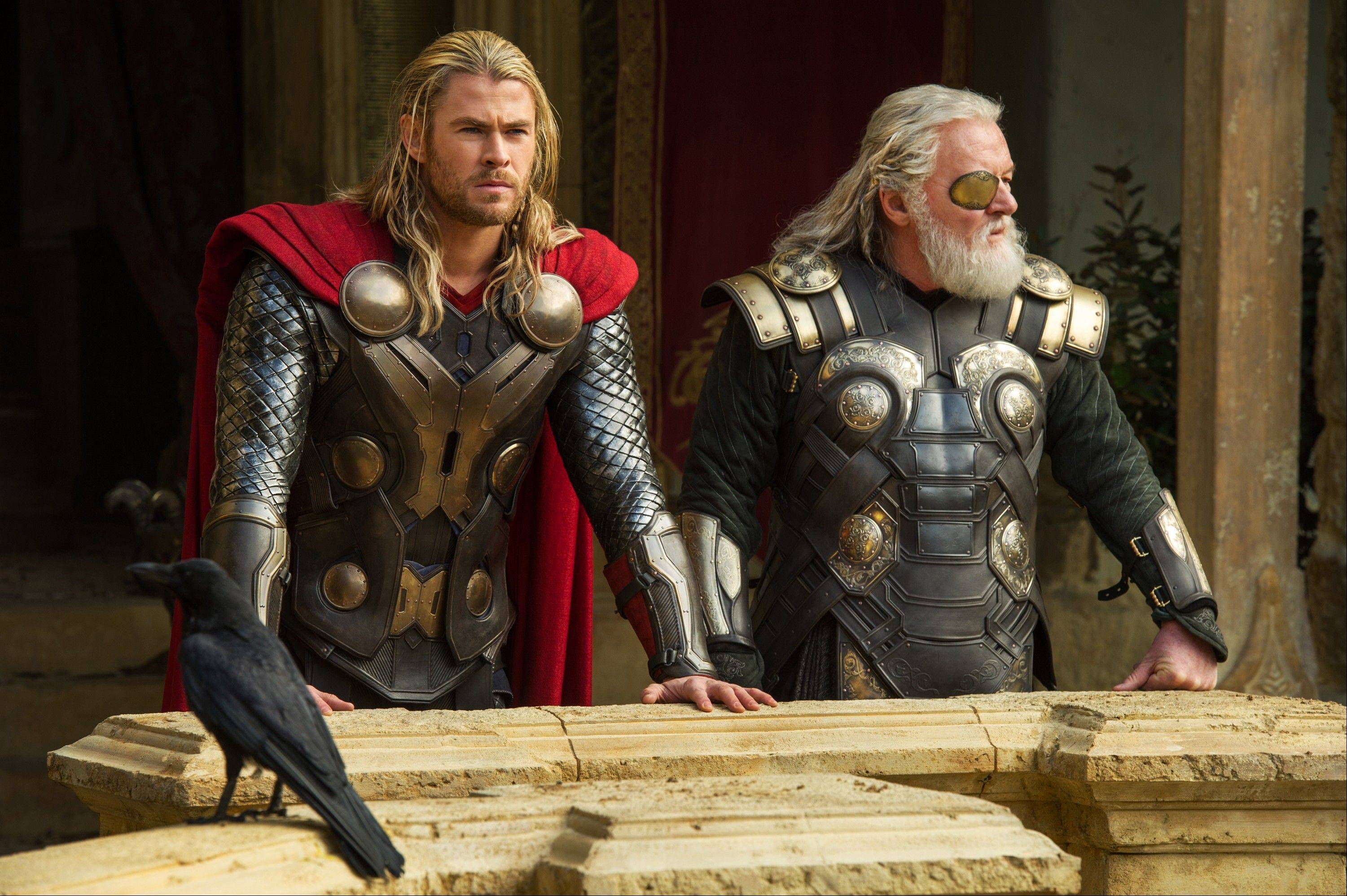 "The God of Thunder (Chris Hemsworth), left, chats with his father, Odin (Anthony Hopkins), in ""Thor: The Dark World."""