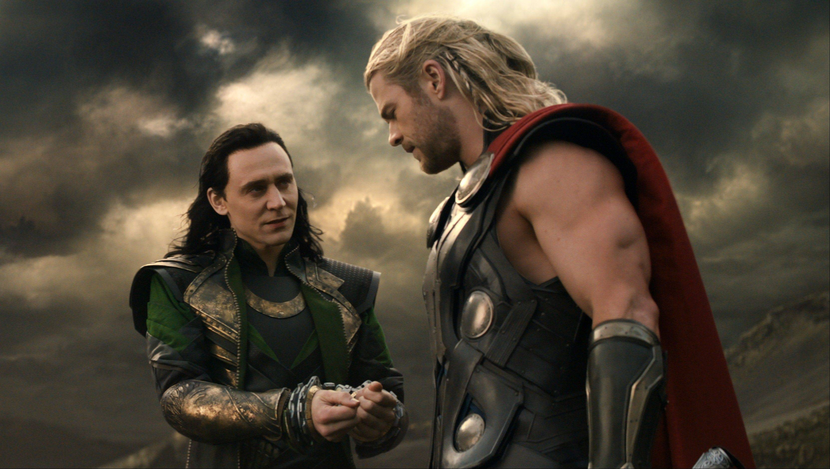"The power-mad Loki (Tom Hiddleston), left, strikes a tentative truce with his brother Thor (Chris Hemsworth) in the sequel ""Thor: The Dark World."""