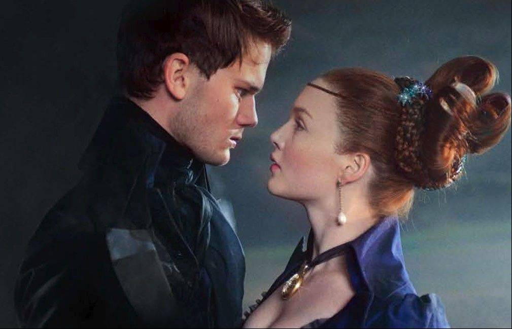 "Pip (Jeremy Irvine) attempts to renew his relationship with Estella (Holliday Grainger) in Mike Newell's remake of ""Great Expectations."""