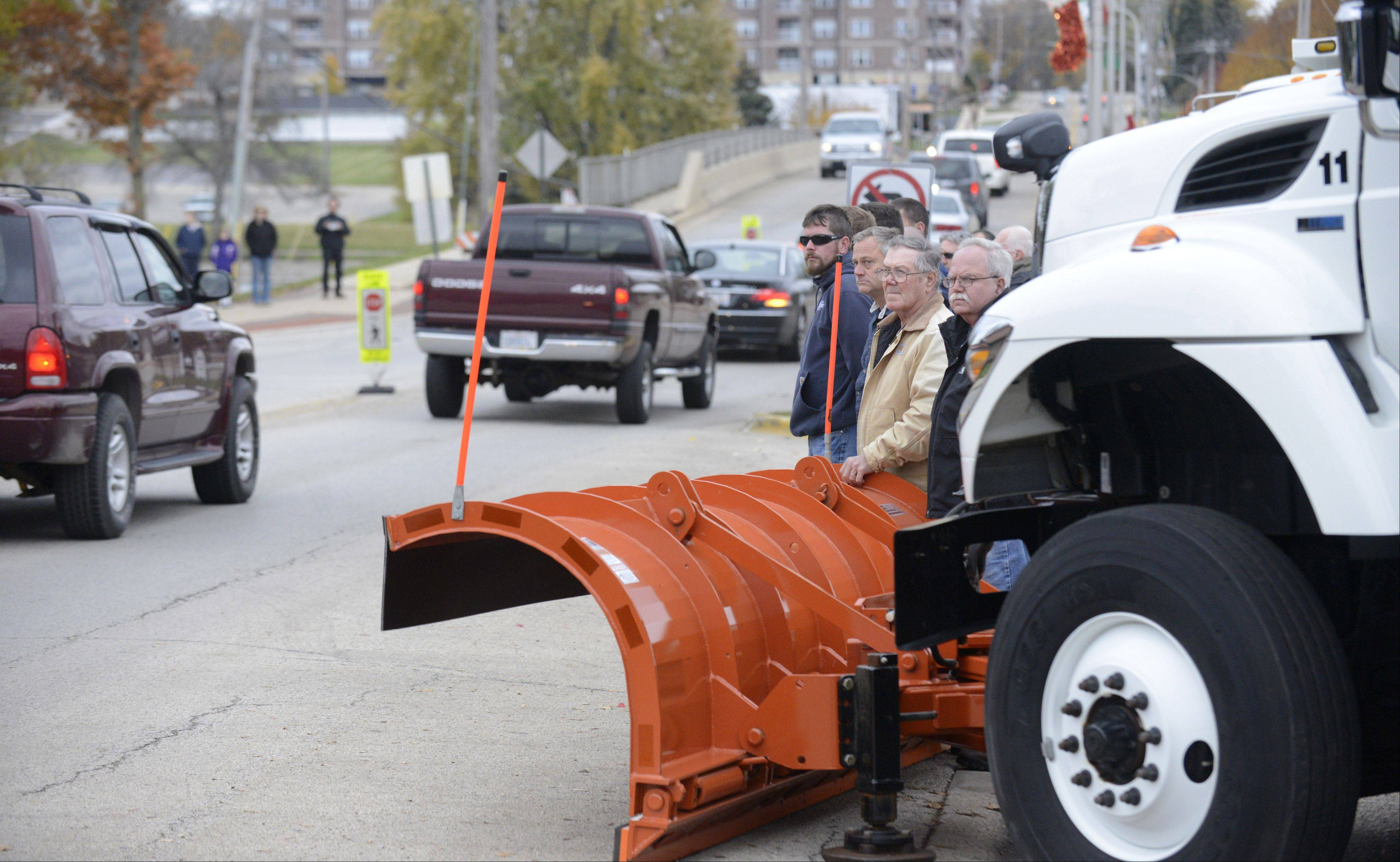 Members of the South Elgin Public Works Department and others gathered on State Street Thursday to watch the funeral procession for Village President Jim Hansen.