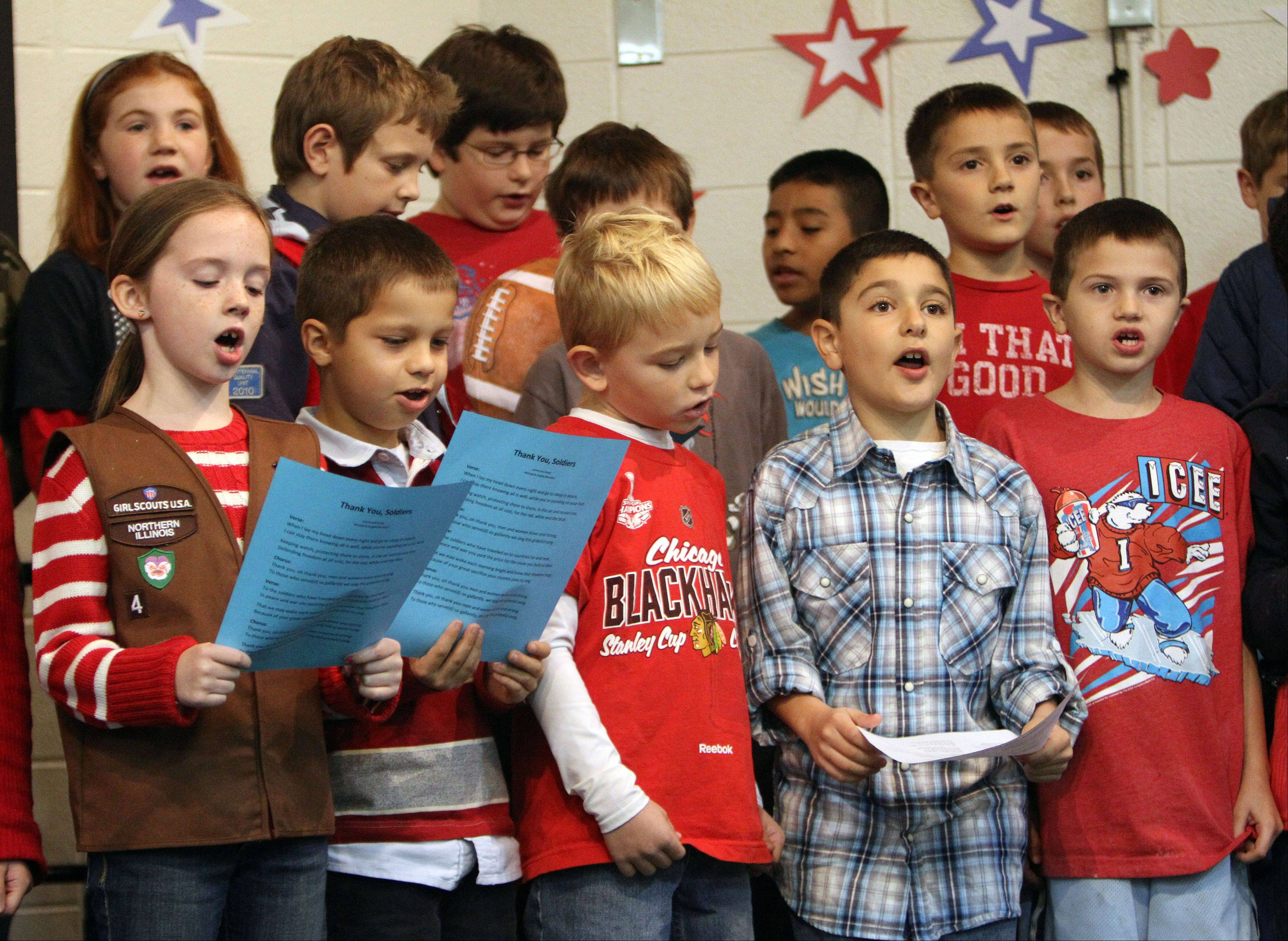 Third graders sing patriotic songs for their guests.
