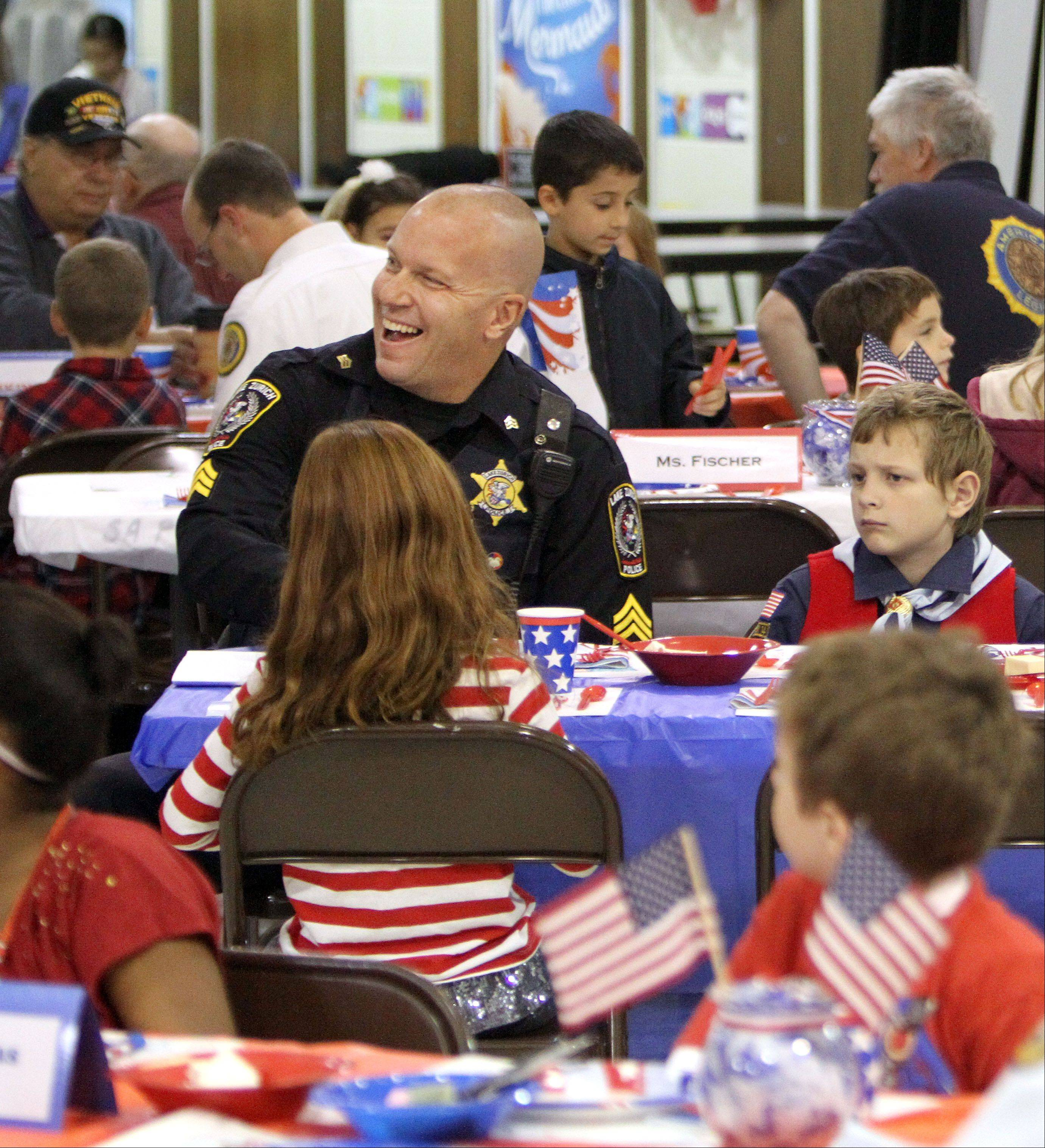 Lake Zurich Police Sgt. Scott Pavlock, an Army veteran, enjoys breakfast with third graders at Sarah Adams Elementary School.