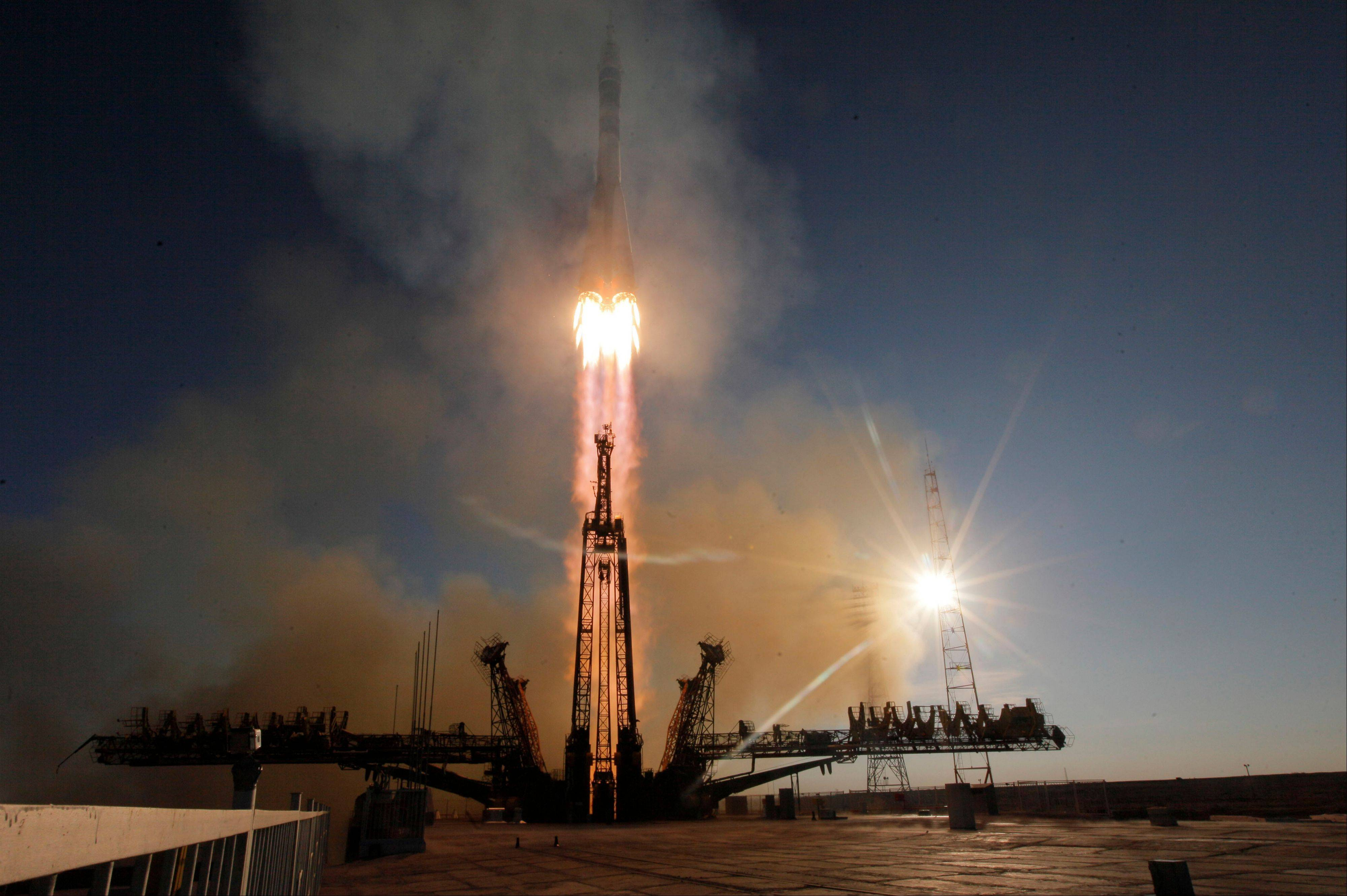 The Russian rocket carries Japanese astronaut Koichi Wakata, Russian cosmonaut Mikhail Tyurin and U.S. astronaut Rick Mastracchio who will deliver an Olympic torch to space as part of the ongoing Olympic torch relay. The torch will be brought back along with the station's current crew.