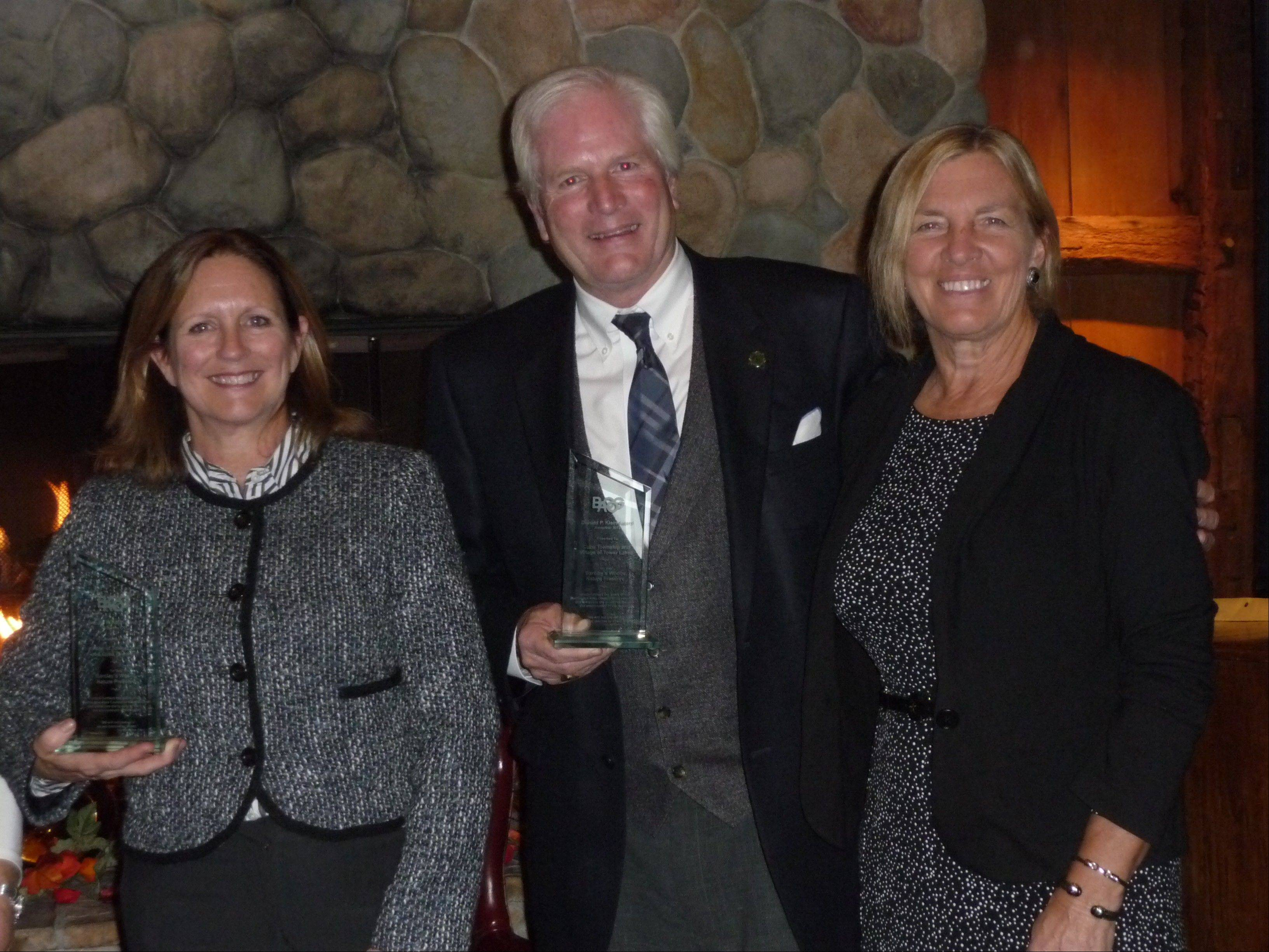 From left, Tower Lakes Village President Kathleen Leitner and Cuba Township Supervisor David Nelson receive the 2013 Donald P. Klein award from Barrington Area Council of Governments Chairwoman and South Barrington Village President Paula McCombie.