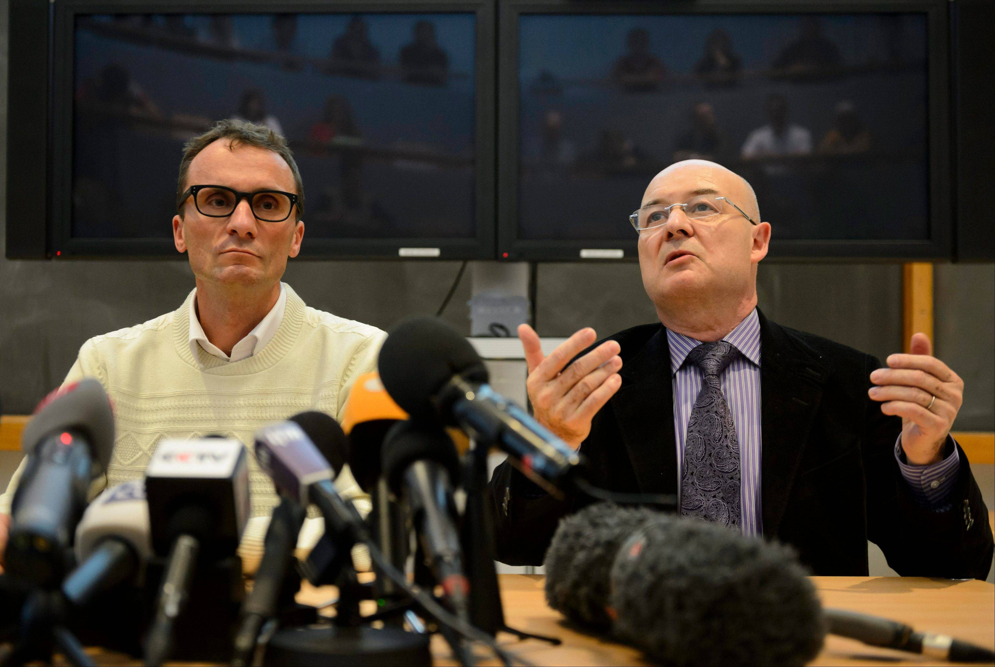 Swiss professors Francois Bochud, left, and Patrice Mangin, present a forensics report concerning the late President Yasser Arafat. The scientists concluded that Arafat ingested lethal radioactive polonium before his death nine years ago, and it could not have been by accident.
