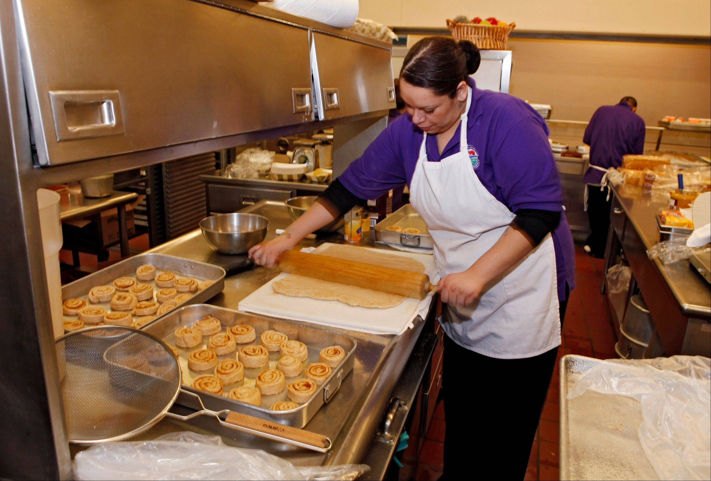 Alexes Garcia makes cinnamon rolls using apple sauce instead of trans fats. The FDA planned to announce Thursday it will require the food industry to gradually phase out all trans fats, saying they are a threat to people's health.
