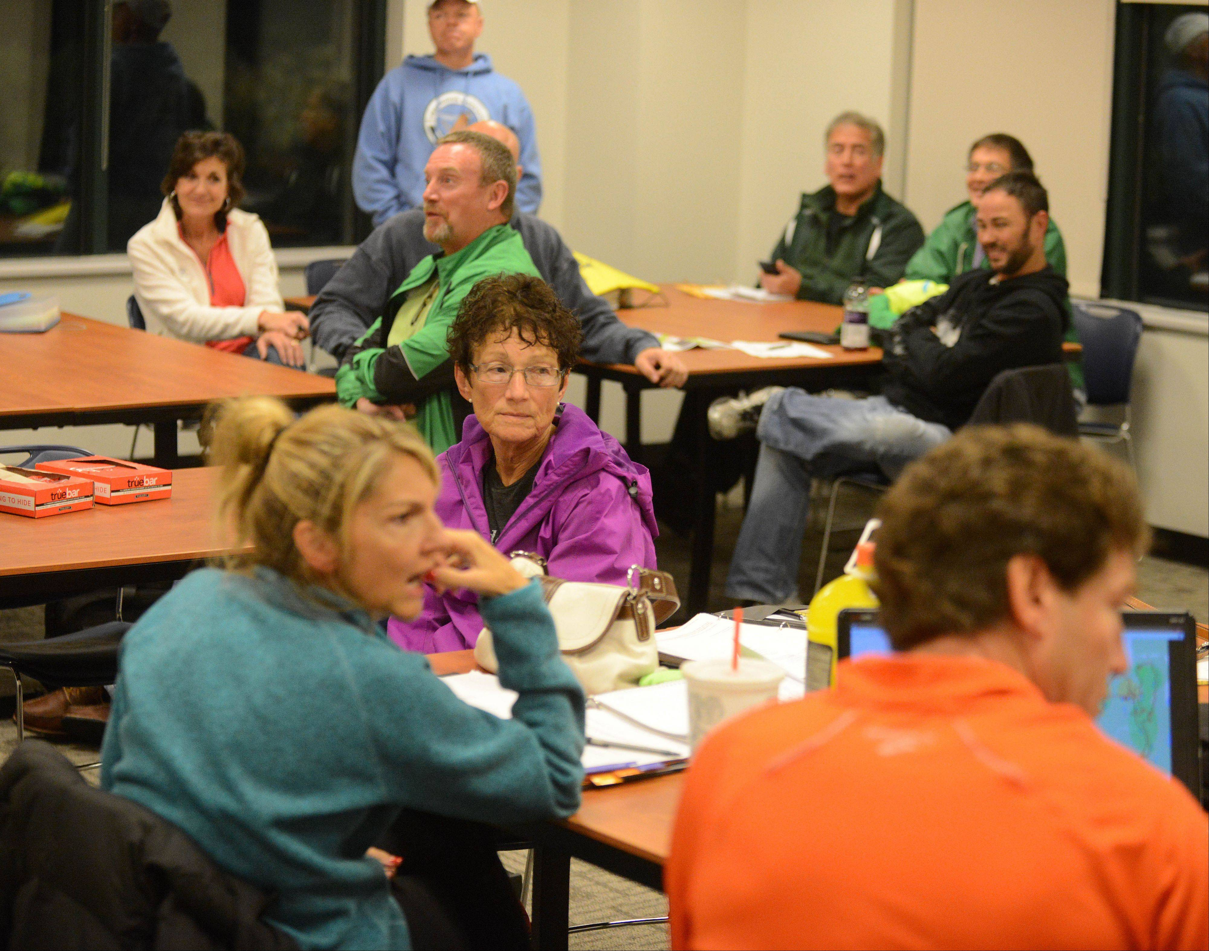 Some of the roughly 850 volunteers who will make the Edward Hospital Naperville Marathon and Half Marathon possible get a briefing from race directors during a meeting in October.