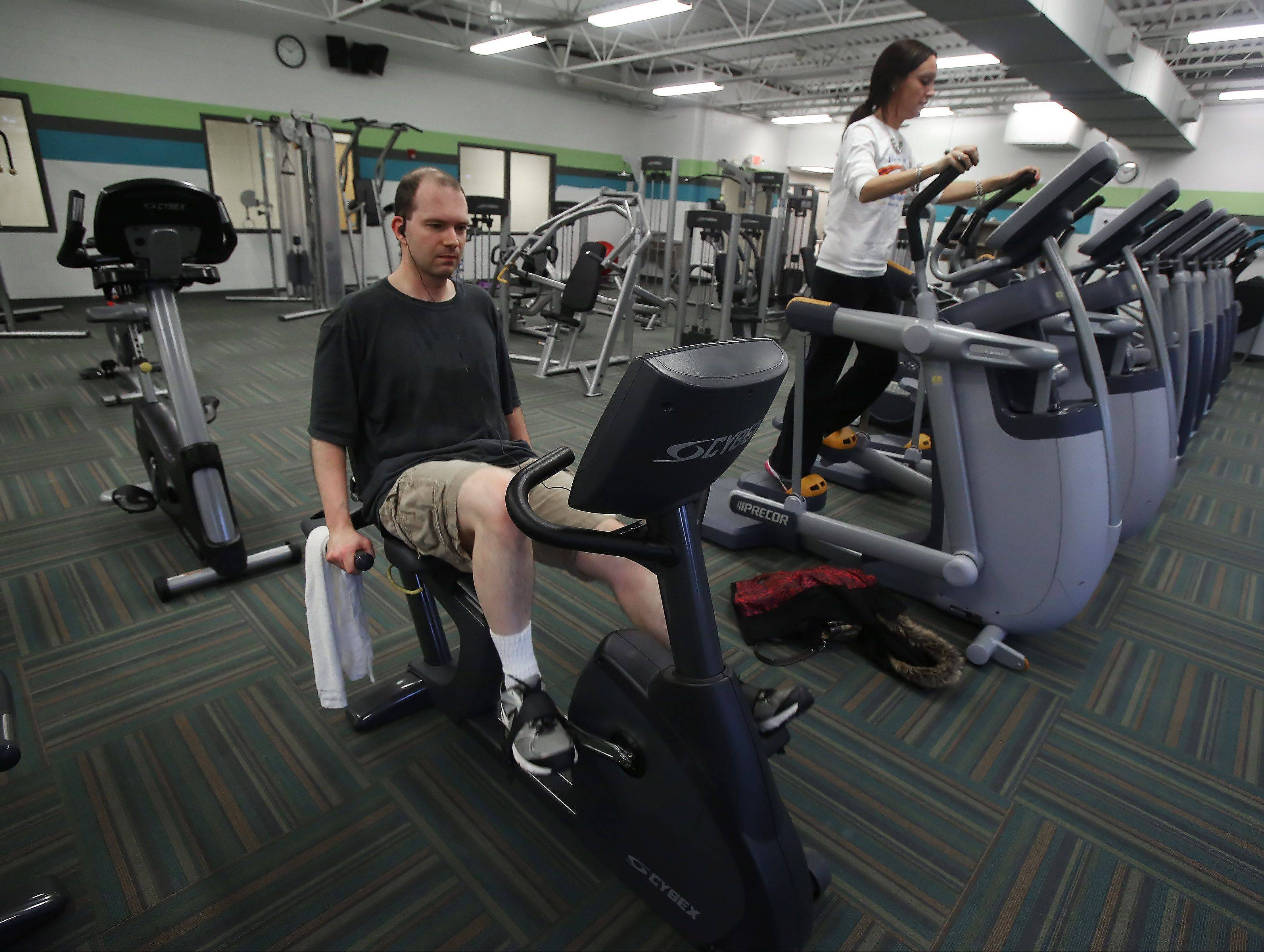 Todd Miller of Vernon Hills and Lindsay Carty of Libertyville workout at Lakeview Fitness Center in Vernon Hills. The Vernon Hills Park District bought the former Central Lake YMCA facility and property for about $2 million and took over operations at the beginning of the year.