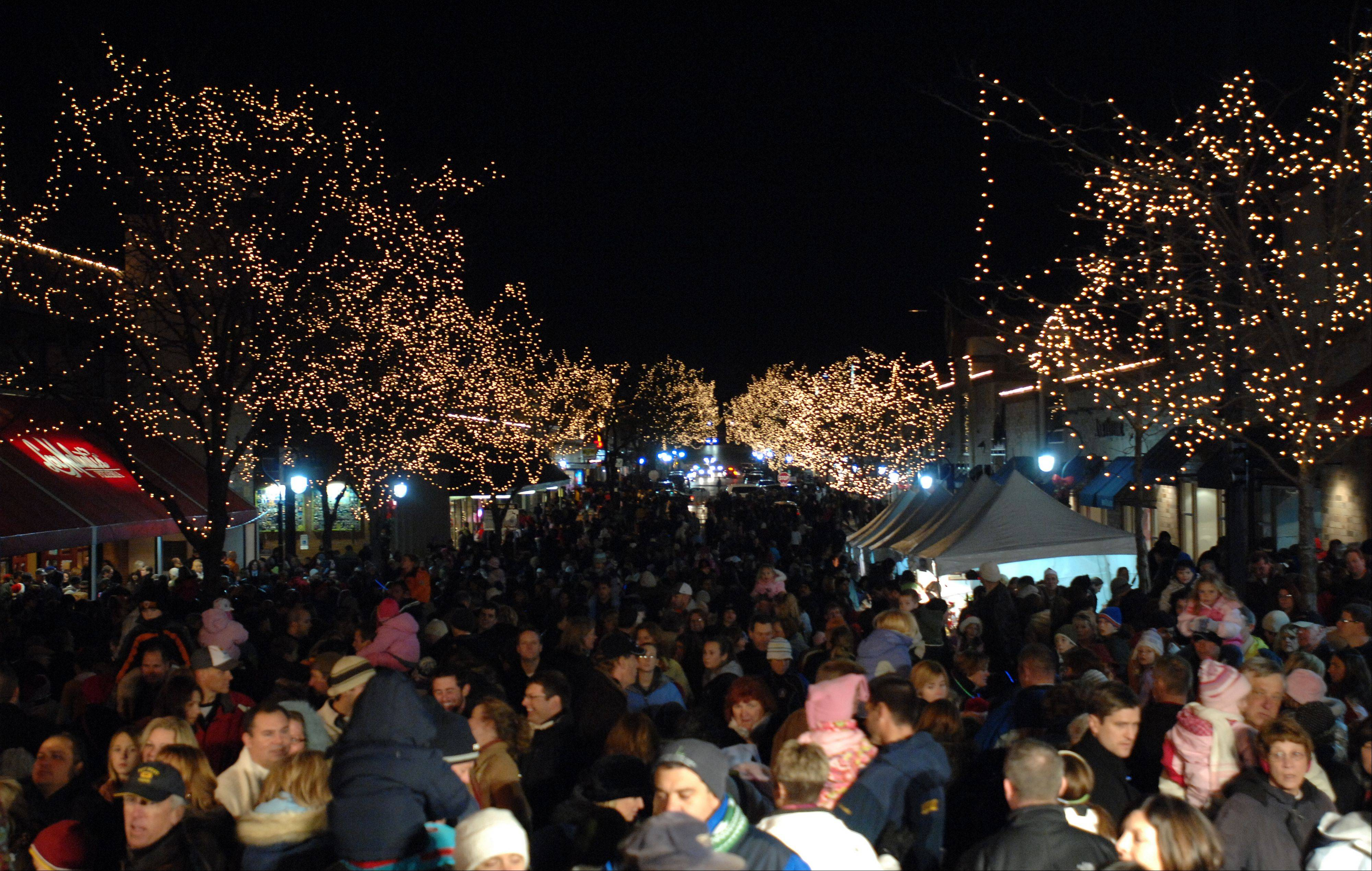 Large crowds have gathered in the past for ceremonies lighting up downtown Naperville for the holiday season. This year's Holiday Grand Illumination event was moved up about three weeks from its usual date after Thanksgiving to Friday, Nov. 8, to precede the inaugural Edward Hospital Naperville Marathon on Sunday.