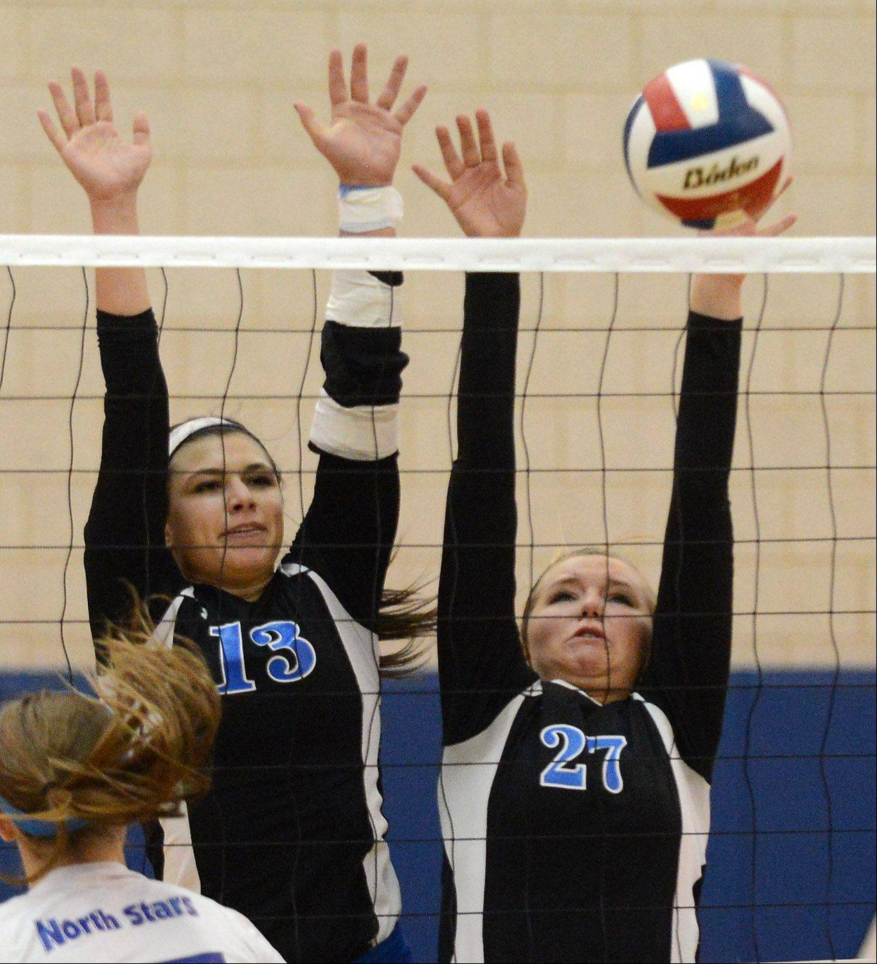 Geneva's Taylor Marmitt (27) gets a block as she and teammate Courtney Caruso defend the net during Thursday's sectional final in Geneva.
