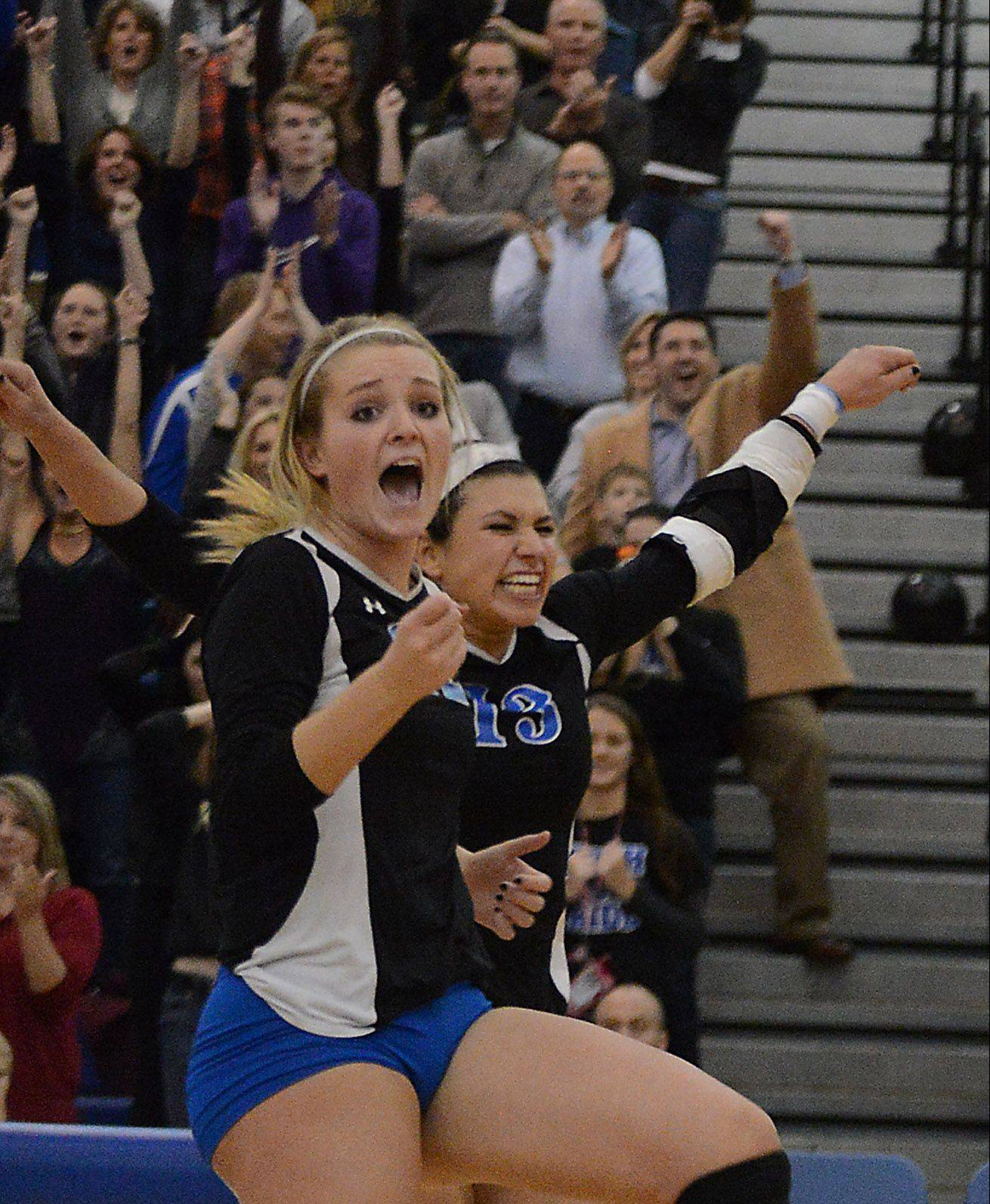 Geneva's Maddie Courter, left, Courtney Caruso and all the Vikings fans behind them celebrate the 25th point of Game 3.