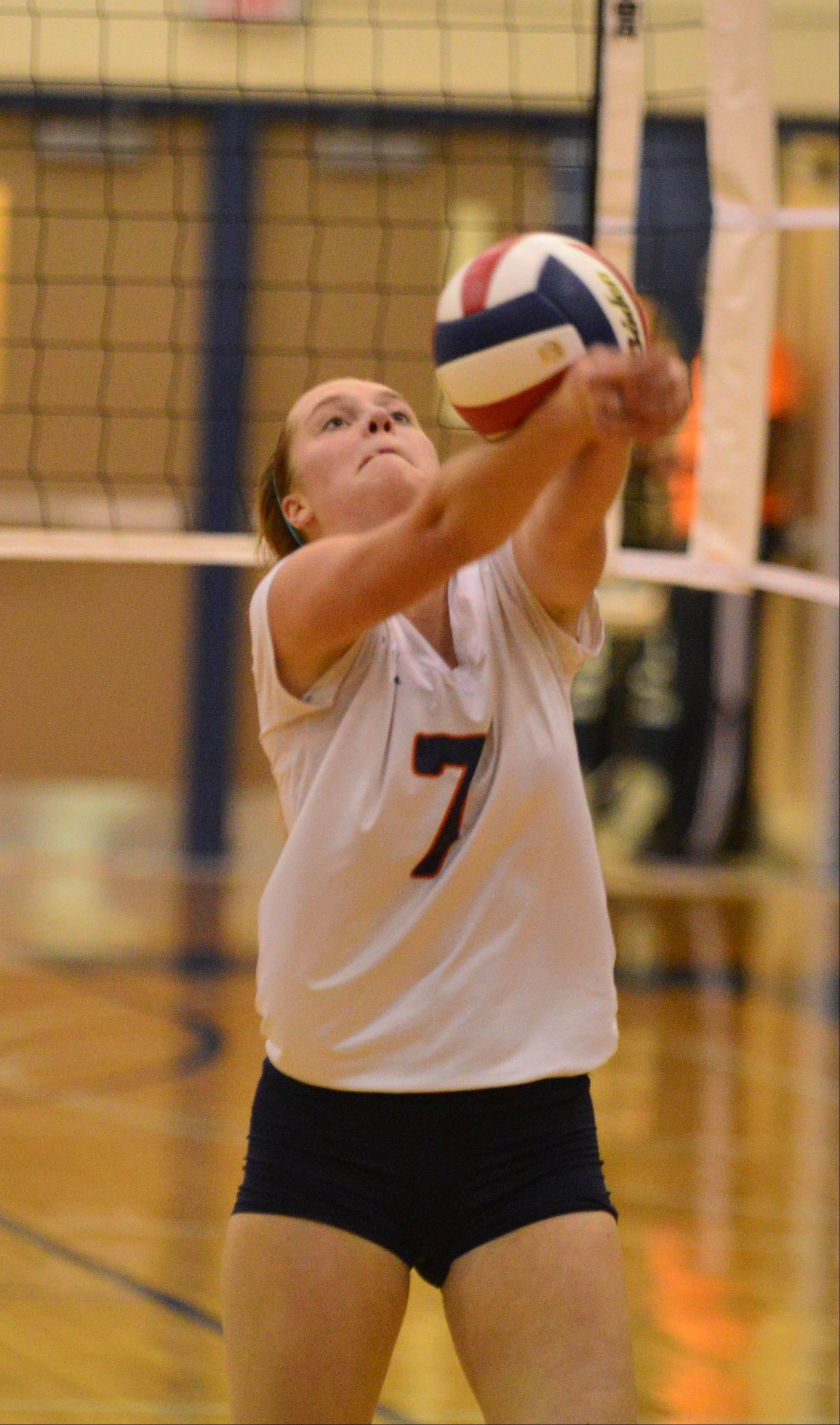 Emily Kwak of Naperville North bumps a ball during the Benet vs. Naperville North Class 4A Plainfield South girls volleyball sectional final Thursday.