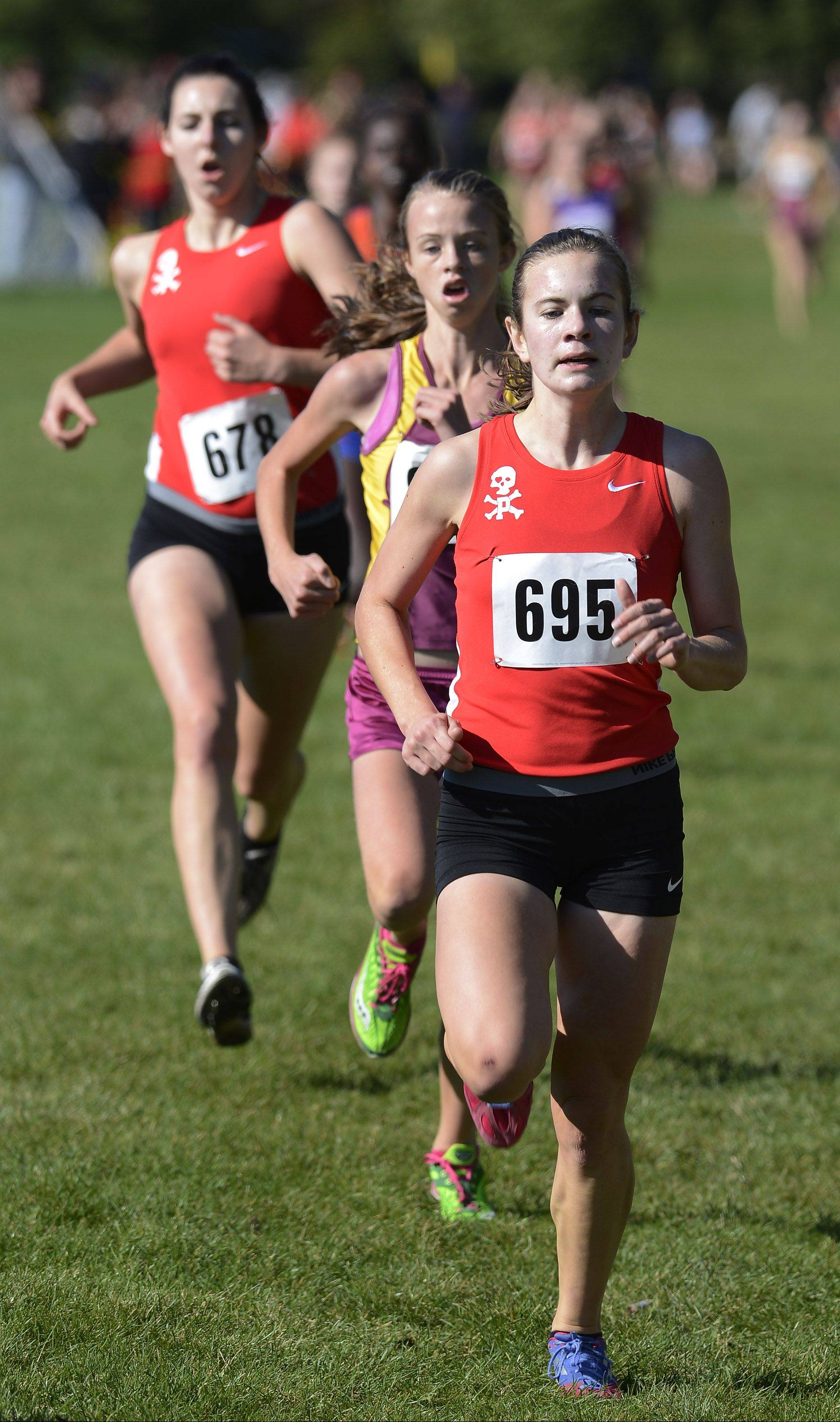 Palatine sophomore Kelly O'Brien of Palatine, front, leads Elie O'Connell of Schaumburg and Pirates senior Liz Cox during the Mid-Suburban League meet at Willow Stream Park in Buffalo Grove.