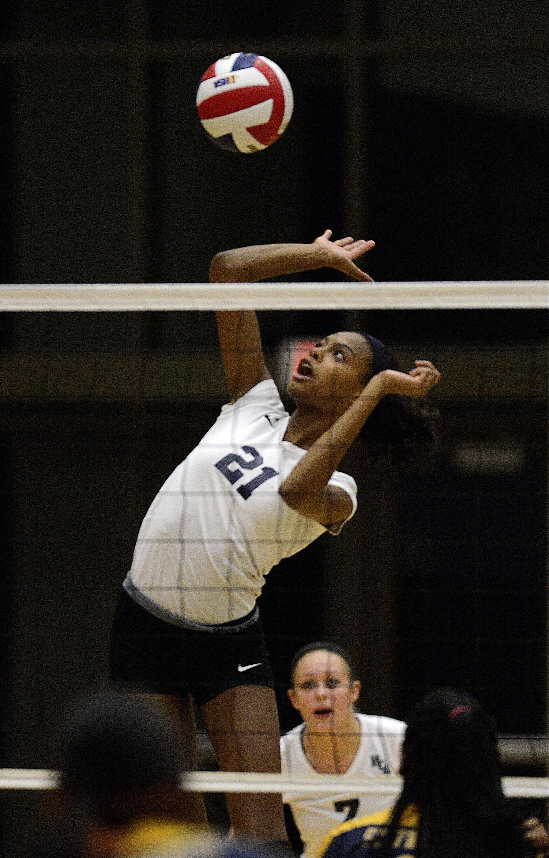 Harvest Christian Academy's Mikayla Robinson spikes the volleyball against St. Francis de Sales in the sectional final in Elgin Thursday.