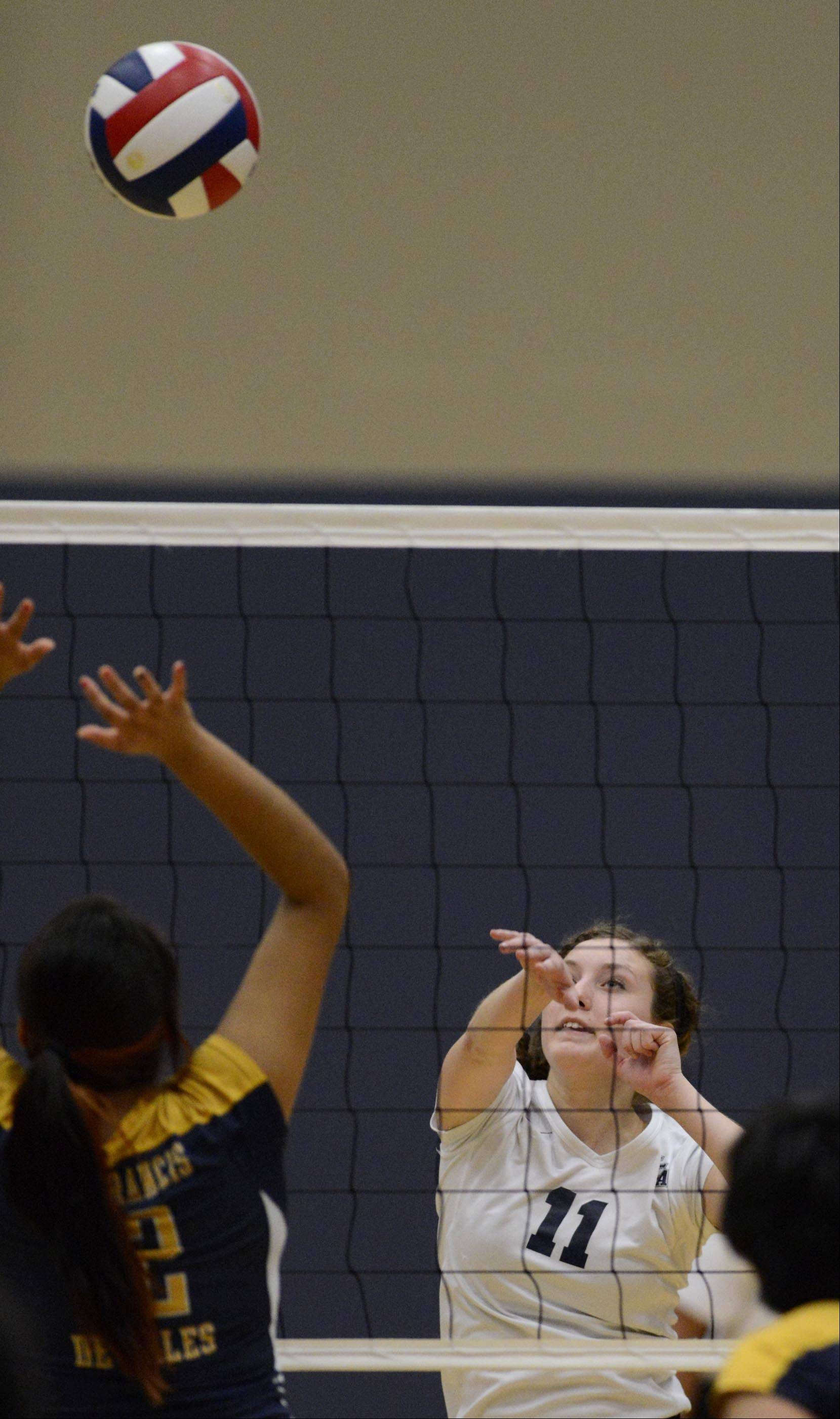 Harvest Christian Academy's Chloe Corbett hits against St. Francis de Sales in the sectional final in Elgin Thursday.
