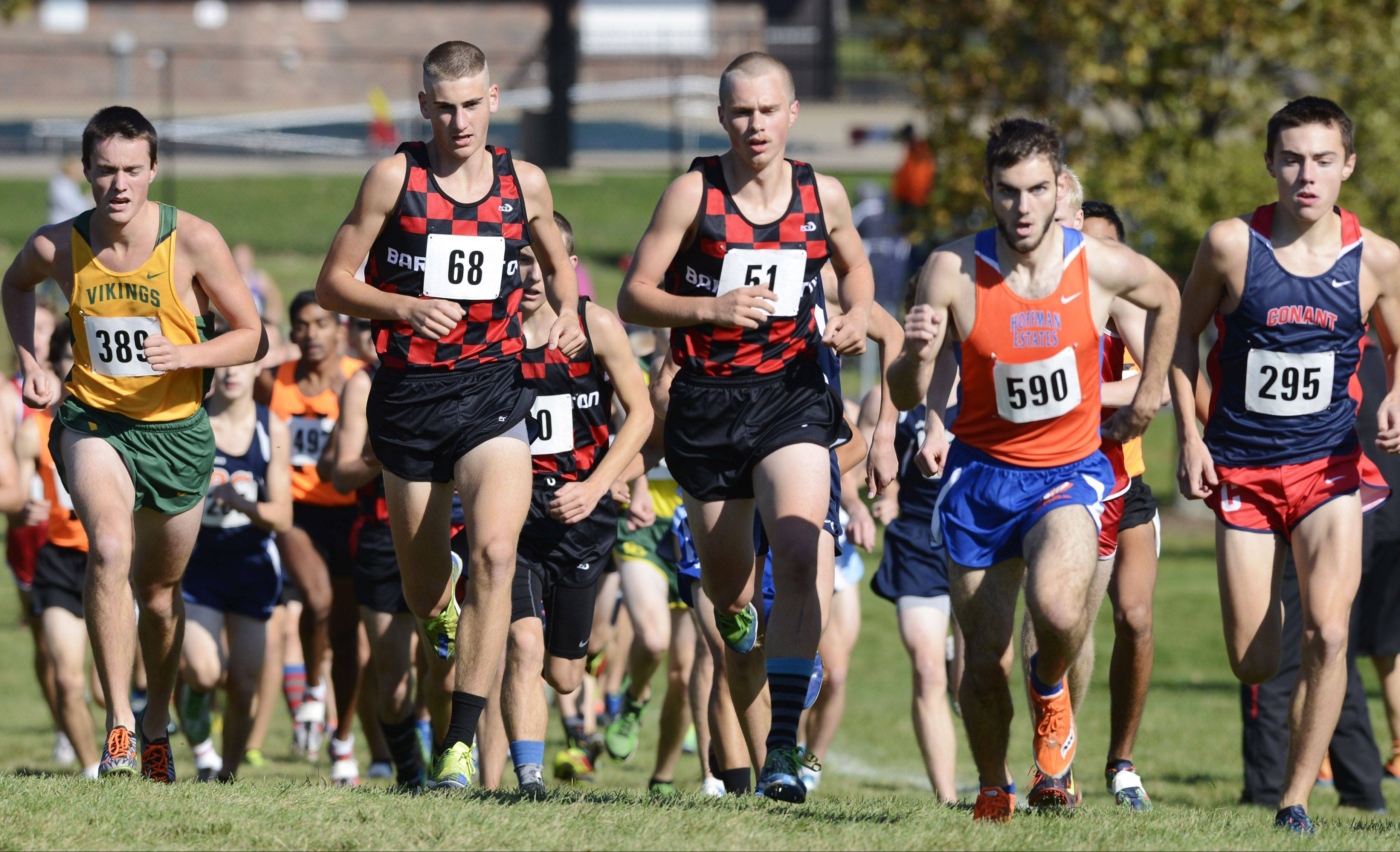 A strong cast of Mid-Suburban League runners including, from left, Fremd's Harry Winter, Barrington's Konrad Eiring and Jake Herb, Hoffman Estates' Billy Thomas and Conant's Zach Dale compete during the MSL meet.