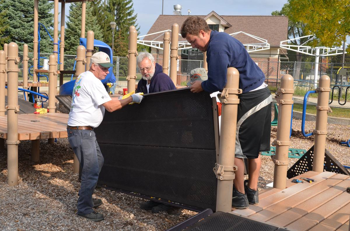 Staff and volunteers from Kids Around the World remove equipment from Community Park in 2012.