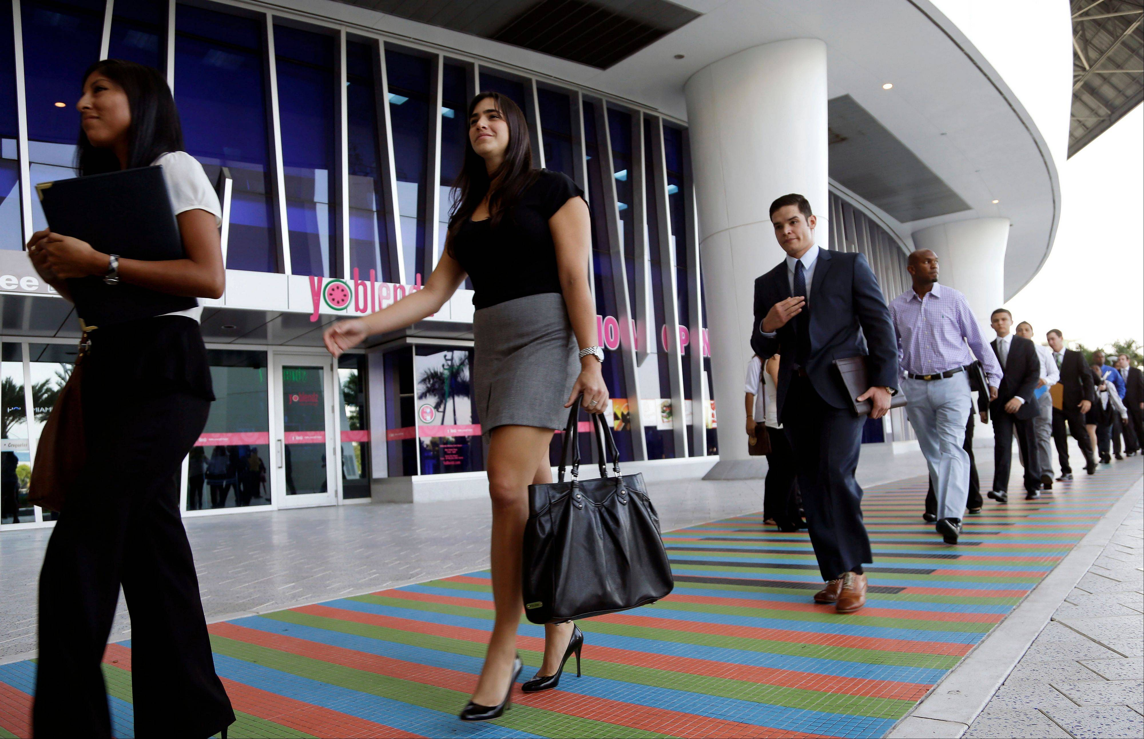 Job applicants arrives for an internship job fair held by the Miami Marlins at Marlins Park in Miami. The government issues the October jobs report today, which had been delayed a week because of the government shutdown.
