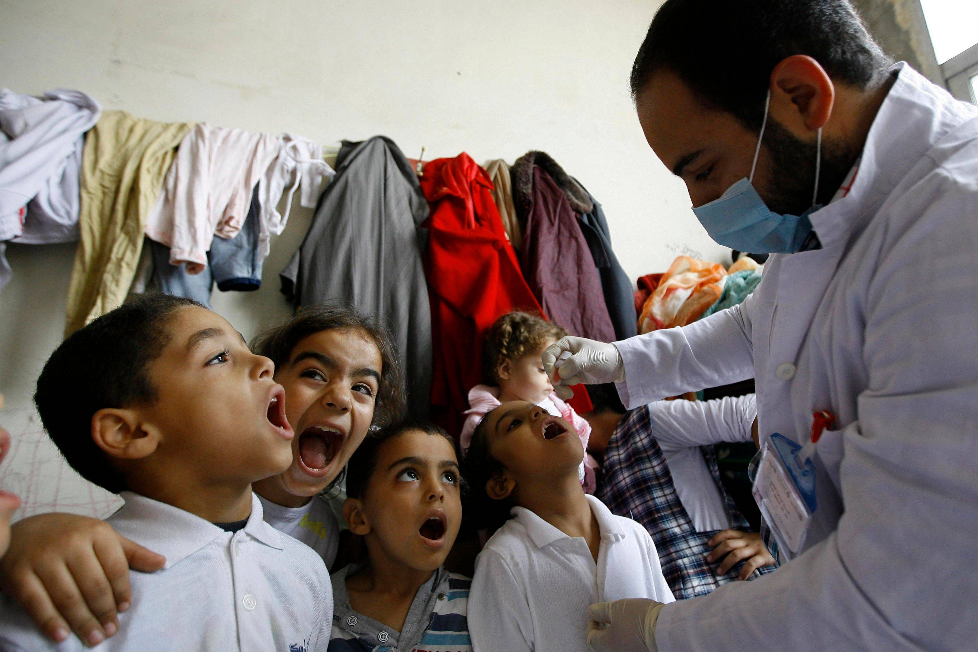 Syrian displaced children line up Thursday to receive vaccination against polio at one of the Syrian refugee camps in the southern port city of Sidon, Lebanon.