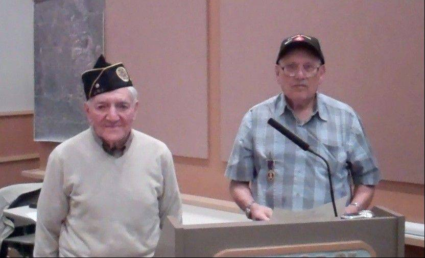 Al Kamikow and Irving Weiner are honored by the Buffalo Grove Village Board for their military service at this week's meeting.