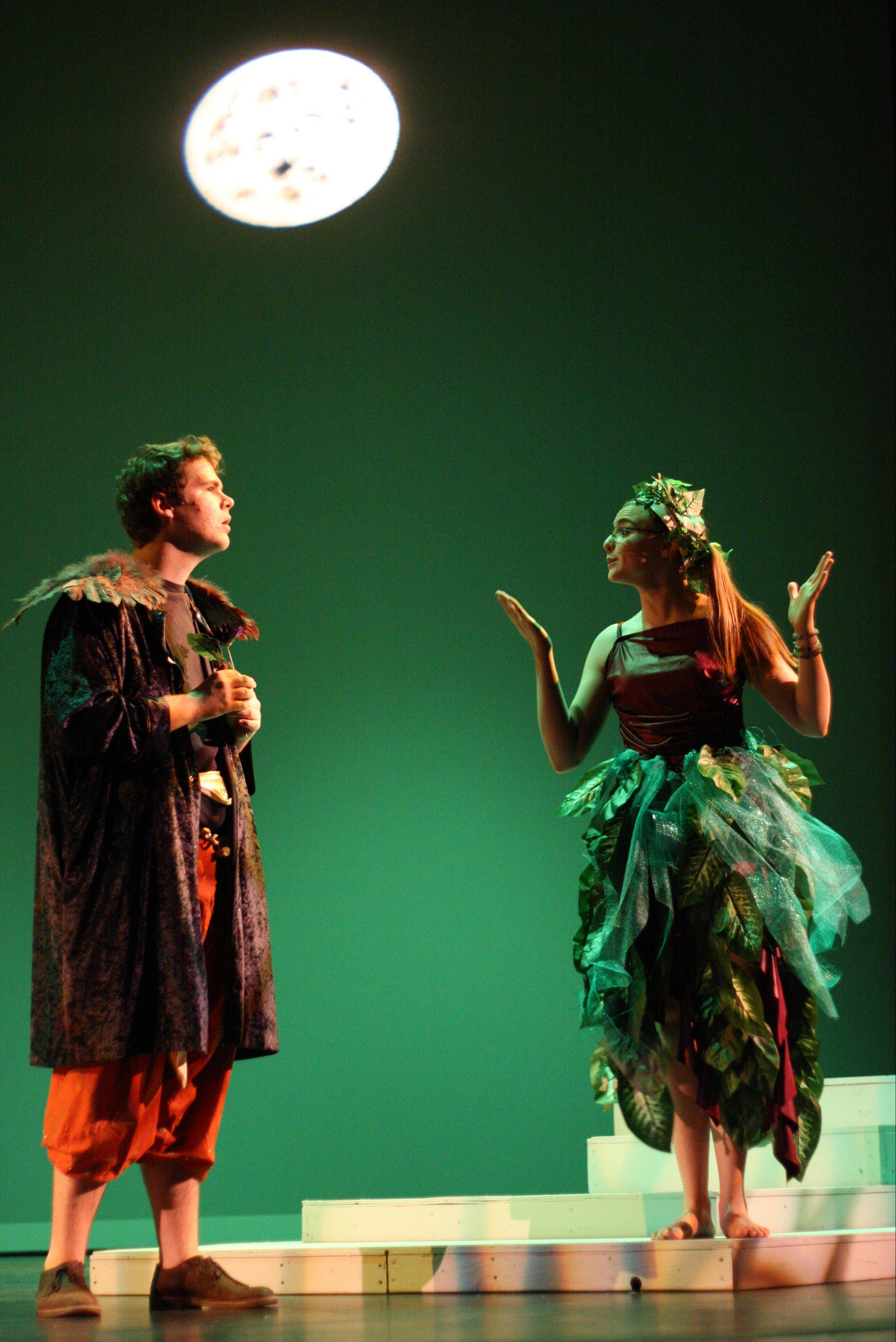 "During a rehearsal for Hampshire High School's production of ""A Midsummer Night's Dream,"" Puck and Oberon discuss the mischief she has caused after causing Lysander to fall in love with the wrong person. Puck is played by Niki Curatti; Oberon by Thomas Burkhead."
