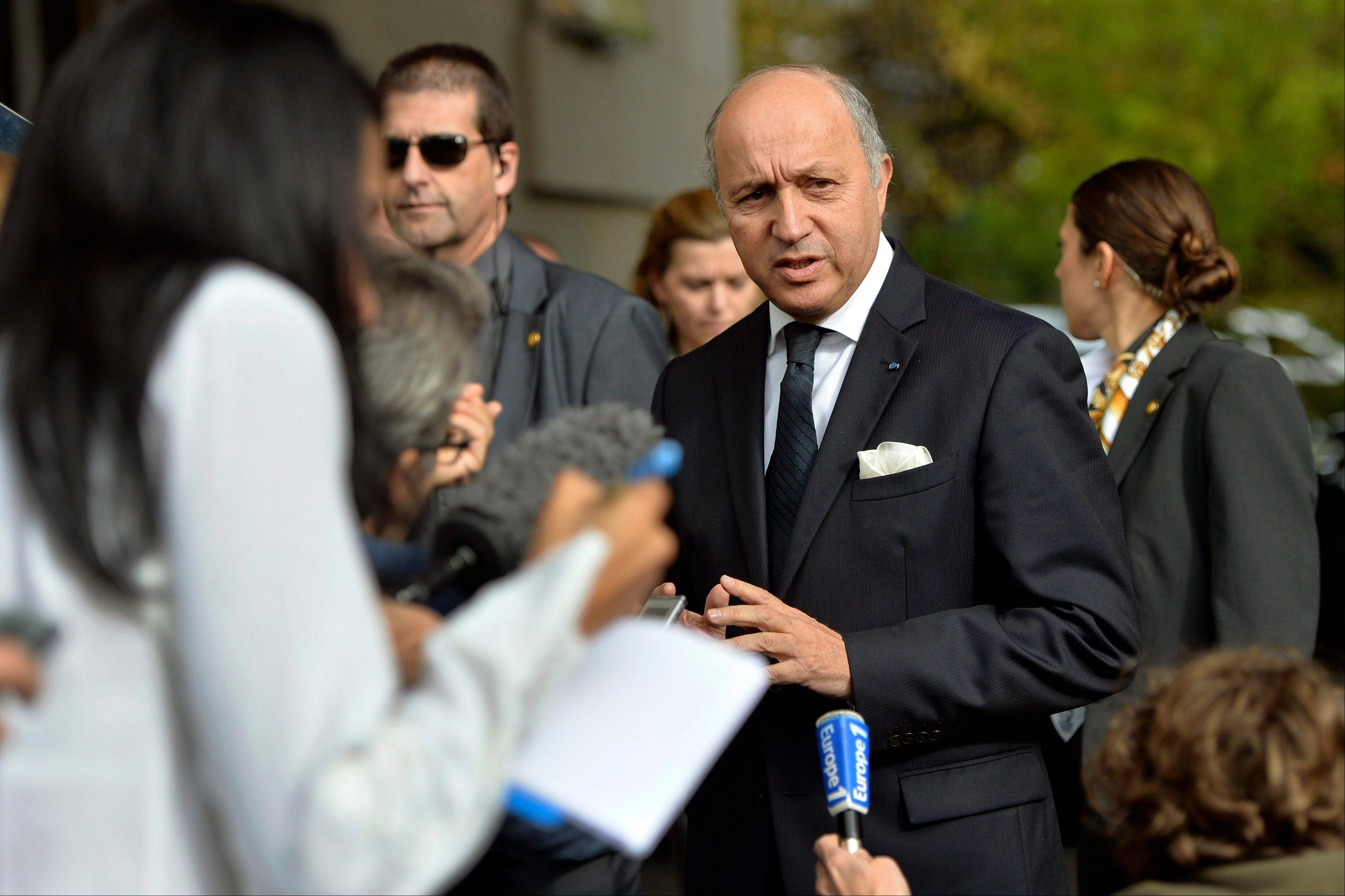 "French foreign minister Laurent Fabius, center, arrives Friday for the second day of closed-door nuclear talks at the United Nations offices in Geneva, Switzerland. Four world powers are dispatching their top diplomats to Geneva on Friday to add their weight to negotiations aimed at putting initial limits on Iran's ability to make atomic weapons. French, British and German foreign ministers are joining U.S. secretary of state John Kerry in Geneva, who will be coming ""to help narrow differences in negotiations,"" according to a U.S. official who spoke on condition of anonymity because he was not authorized to release the information."