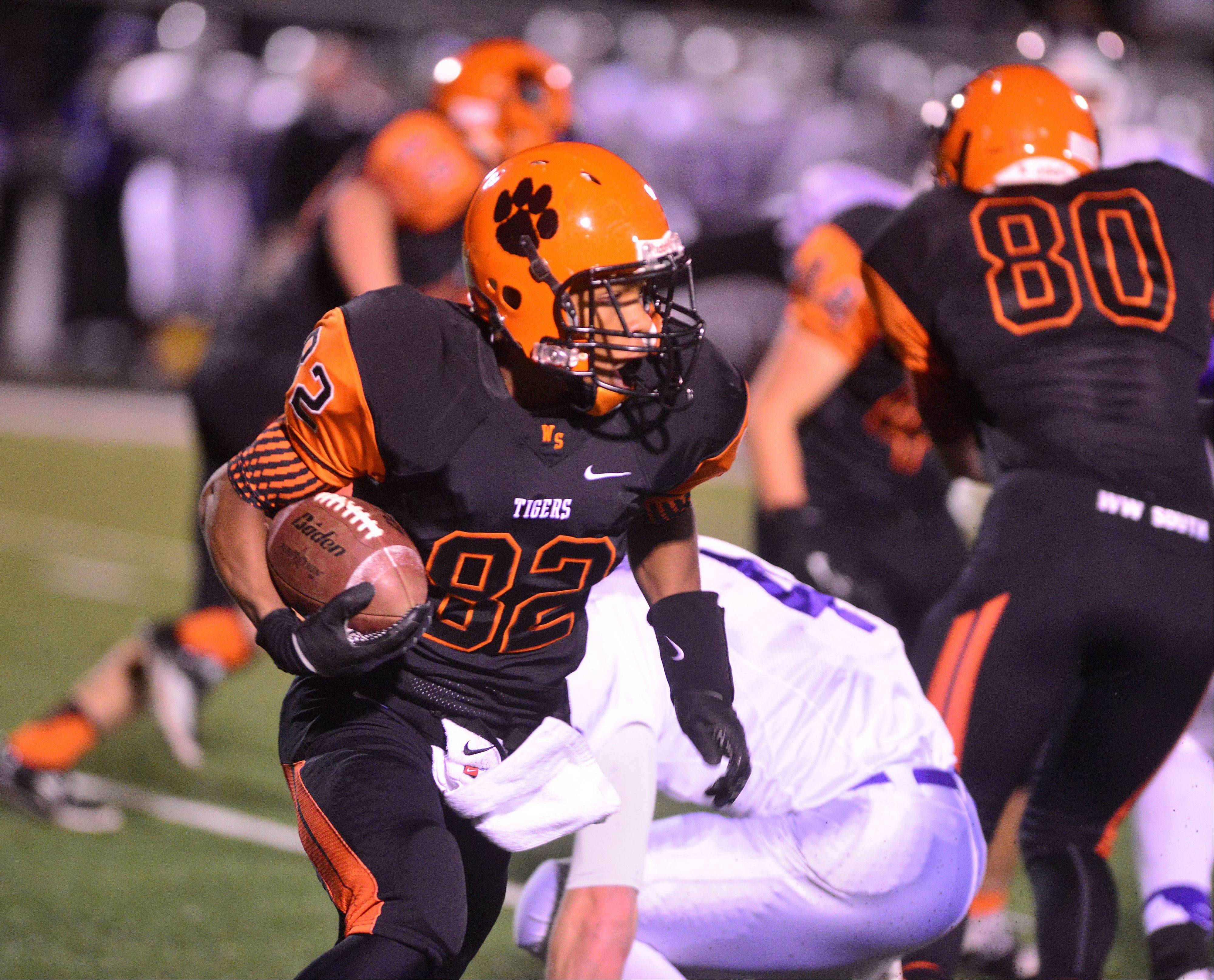 Keishawn Watson of Wheaton Warrenville South moves the ball.