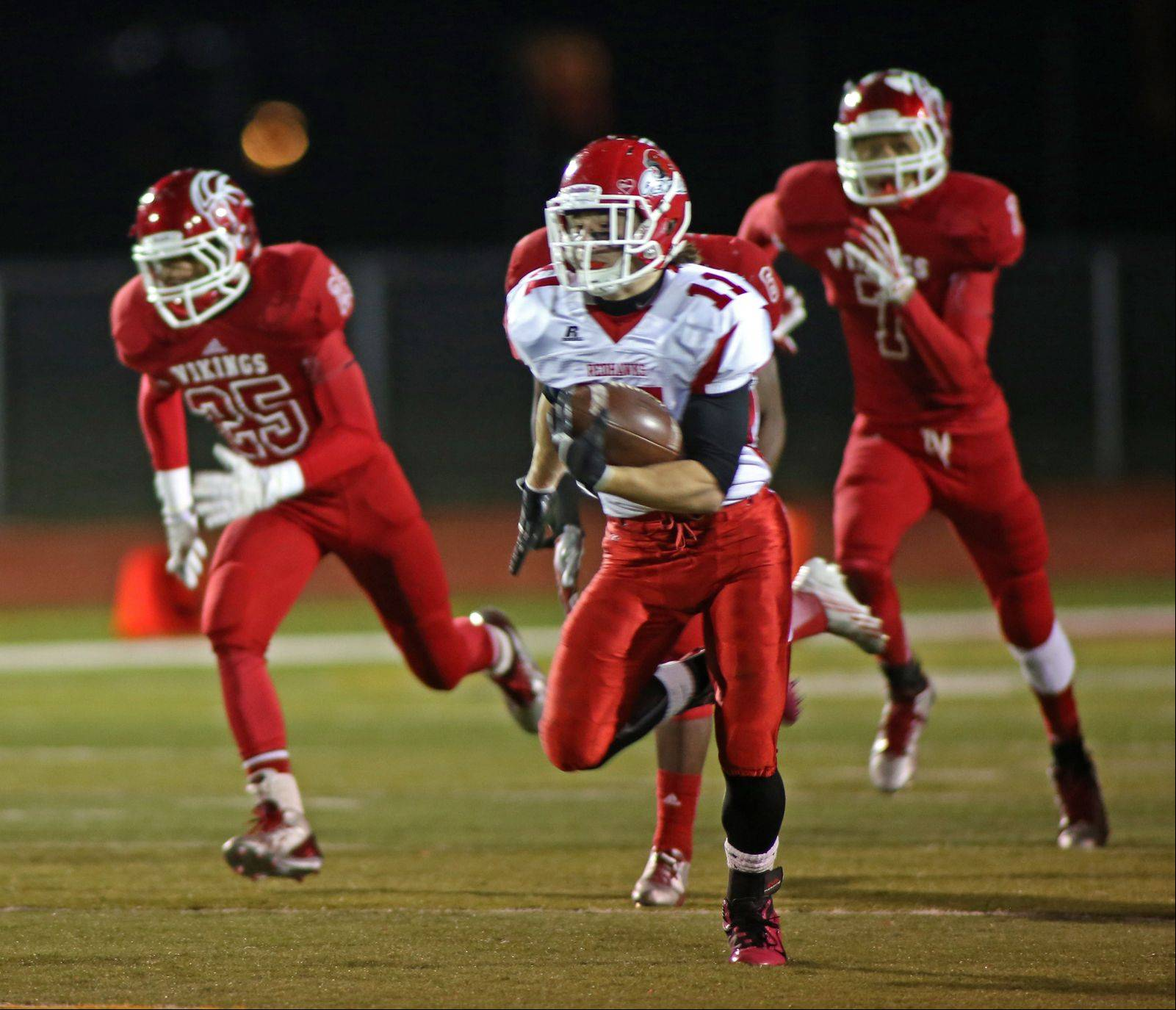 Naperville Central�s Ben Andreas runs for 80 yards to score the game-winning touchdown, giving the Redhawks a 24-21 win.