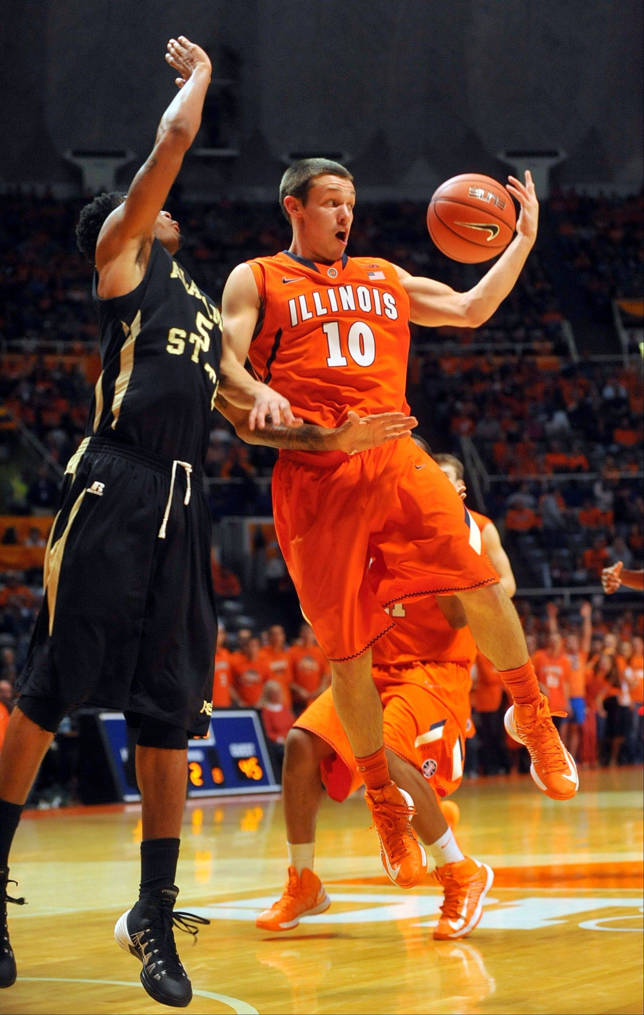 Illinois guard Mike LaTulip (10) drops a pass back near Alabama State's Bobby Brown (5) in the second half in an NCAA college basketball game Friday, Nov. 8, 2013, in Champaign, Ill. (AP Photo/Rick Danzl)