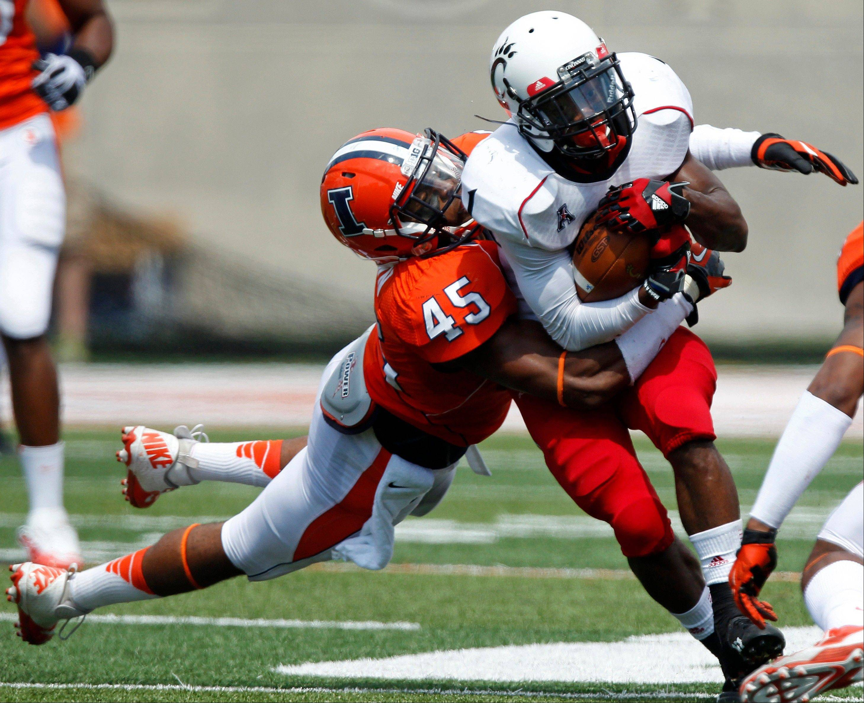 Illinois linebacker Jonathan Brown tackles Cincinnati running back Ralph Abernathy earlier this season.