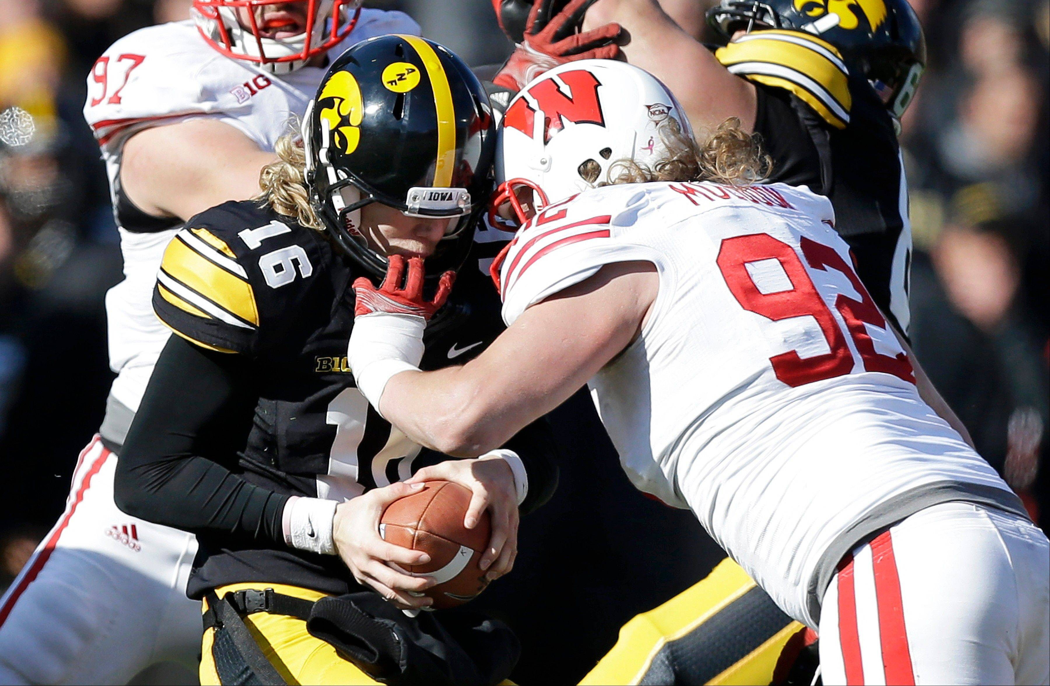 Iowa quarterback C.J. Beathard (16) is sacked by Wisconsin defensive end Pat Muldoon in Iowa City, Iowa. Wisconsin won 28-9.