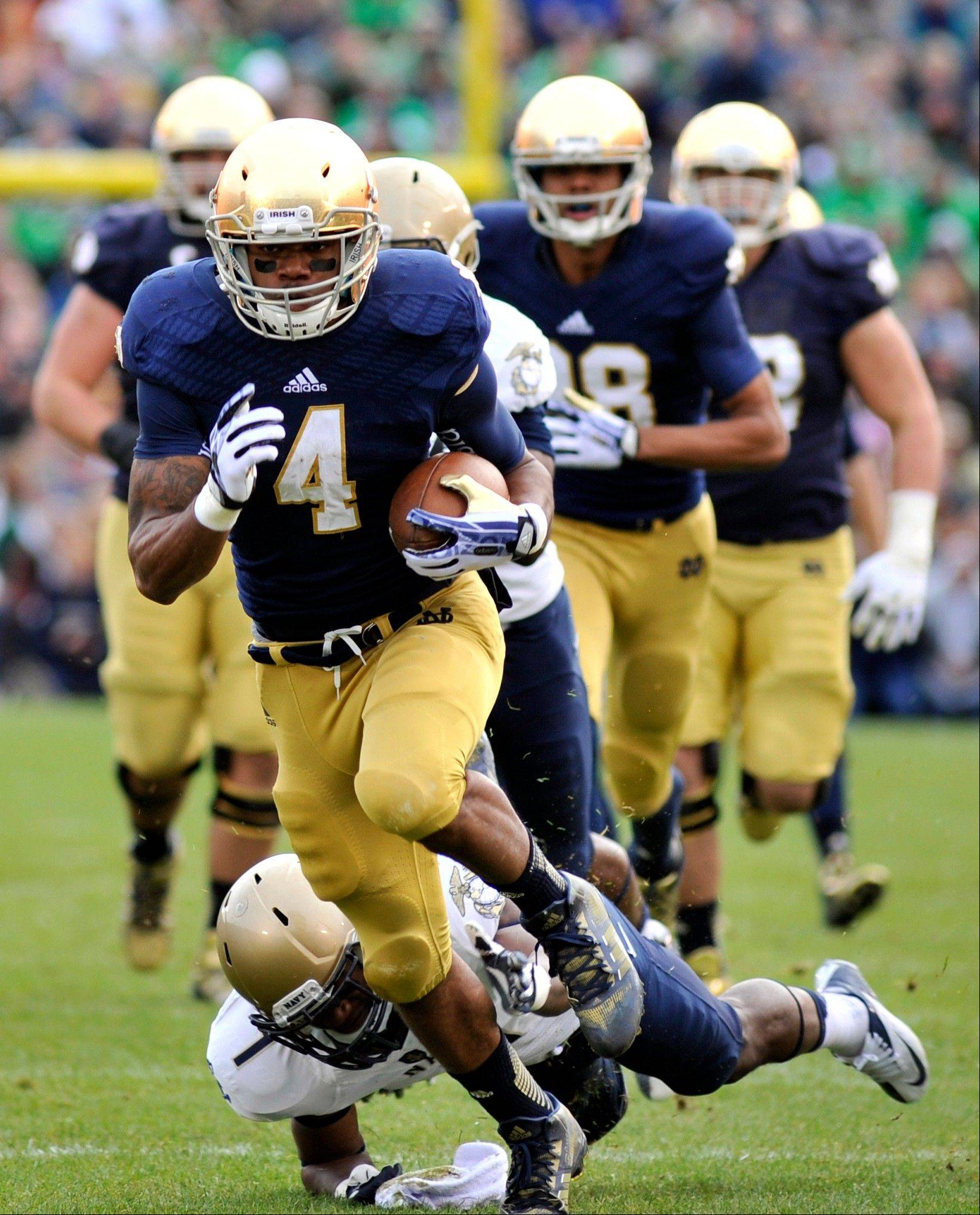 Notre Dame running back George Atkinson III heads to the end zone against Navy.