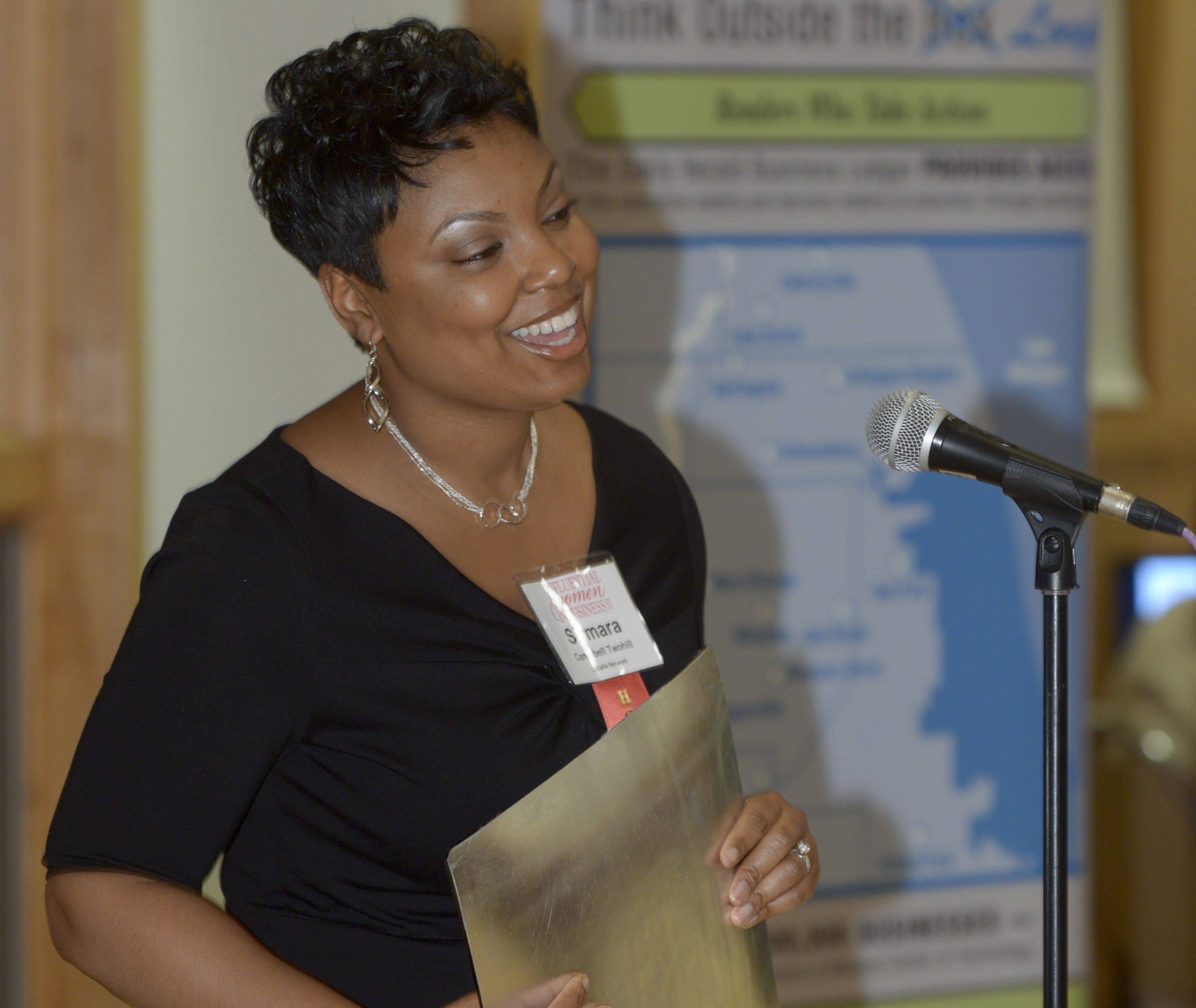 Simara Campbell Twohill, Chief Human Resources Officer for Lasalle Network in Oak Brook accepts her Daily Herald Business Ledger Influential Women in Business award during a ceremony at Danada House in Wheaton, Thursday.