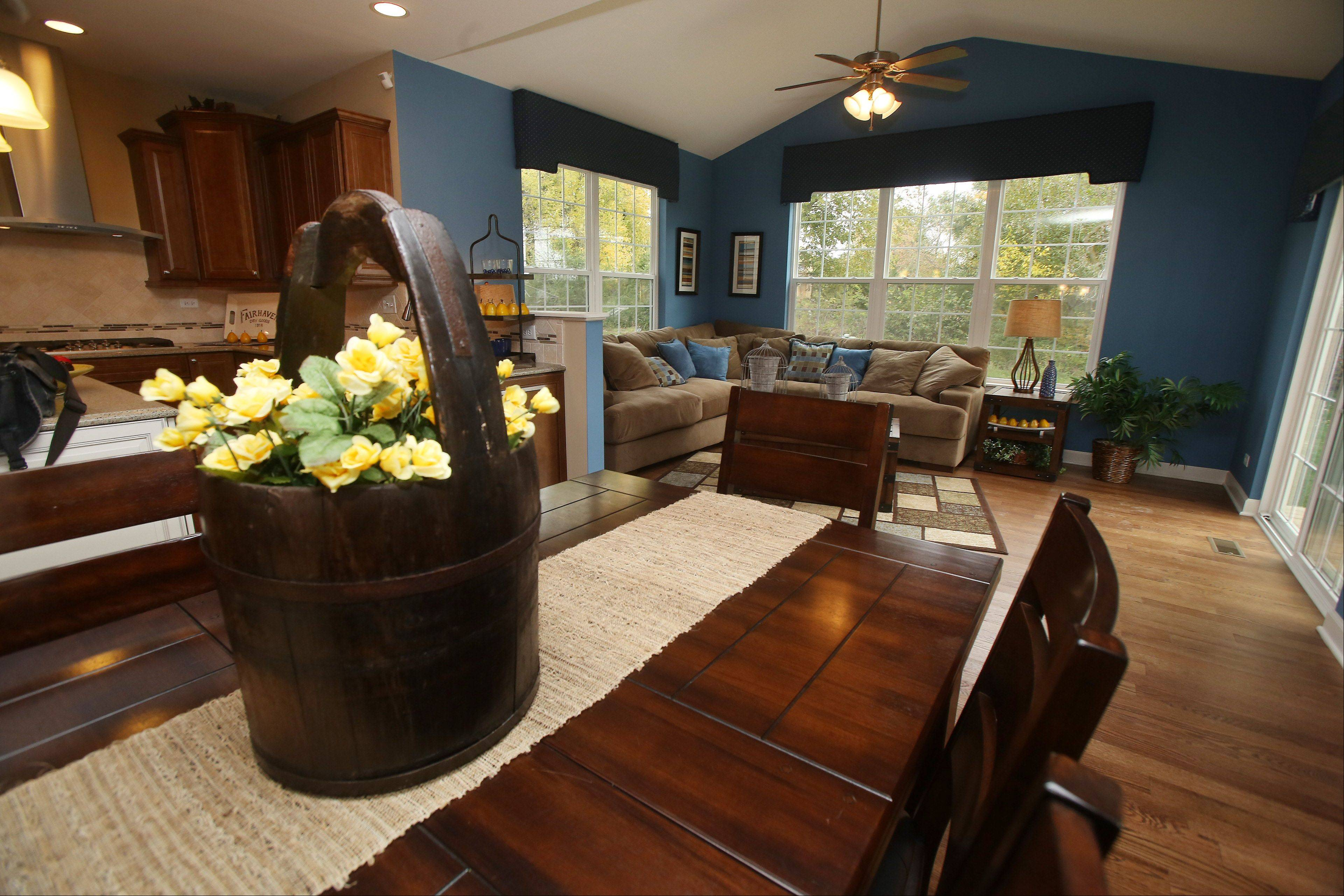 An eat-in kitchen overlooks a family room in the Jasper model home in Walnut Glen.