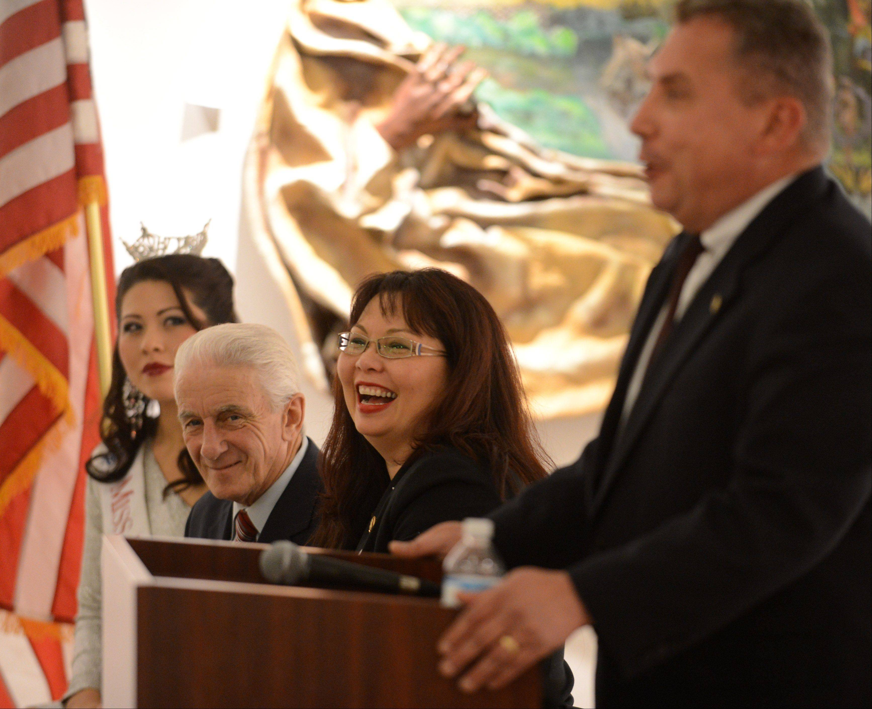 "U.S. Rep. Tammy Duckworth laughs as state senator Mike Noland talks about her before she speaks at ""Salute to Women Veterans: Past and Present"" Friday at Elgin ArtSpace Lofts."