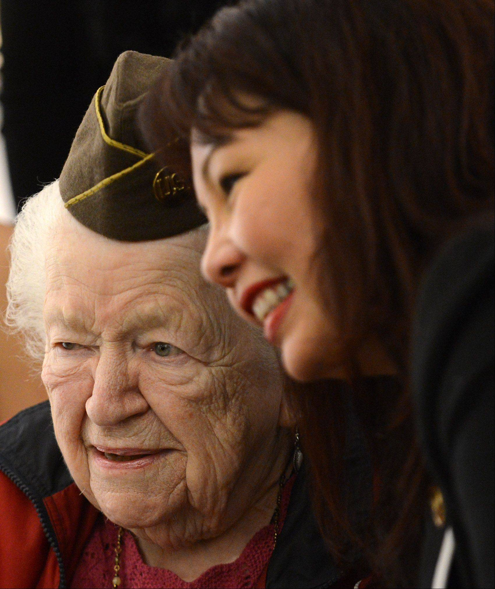 "U.S. Rep. Tammy Duckworth leans in for a picture with Mae Tamgman of Elgin after speaking at the opening of ""Salute to Women Veterans: Past and Present"" Friday at Elgin ArtSpace Lofts. Tamgman, 92, served as a WAC in World War II."