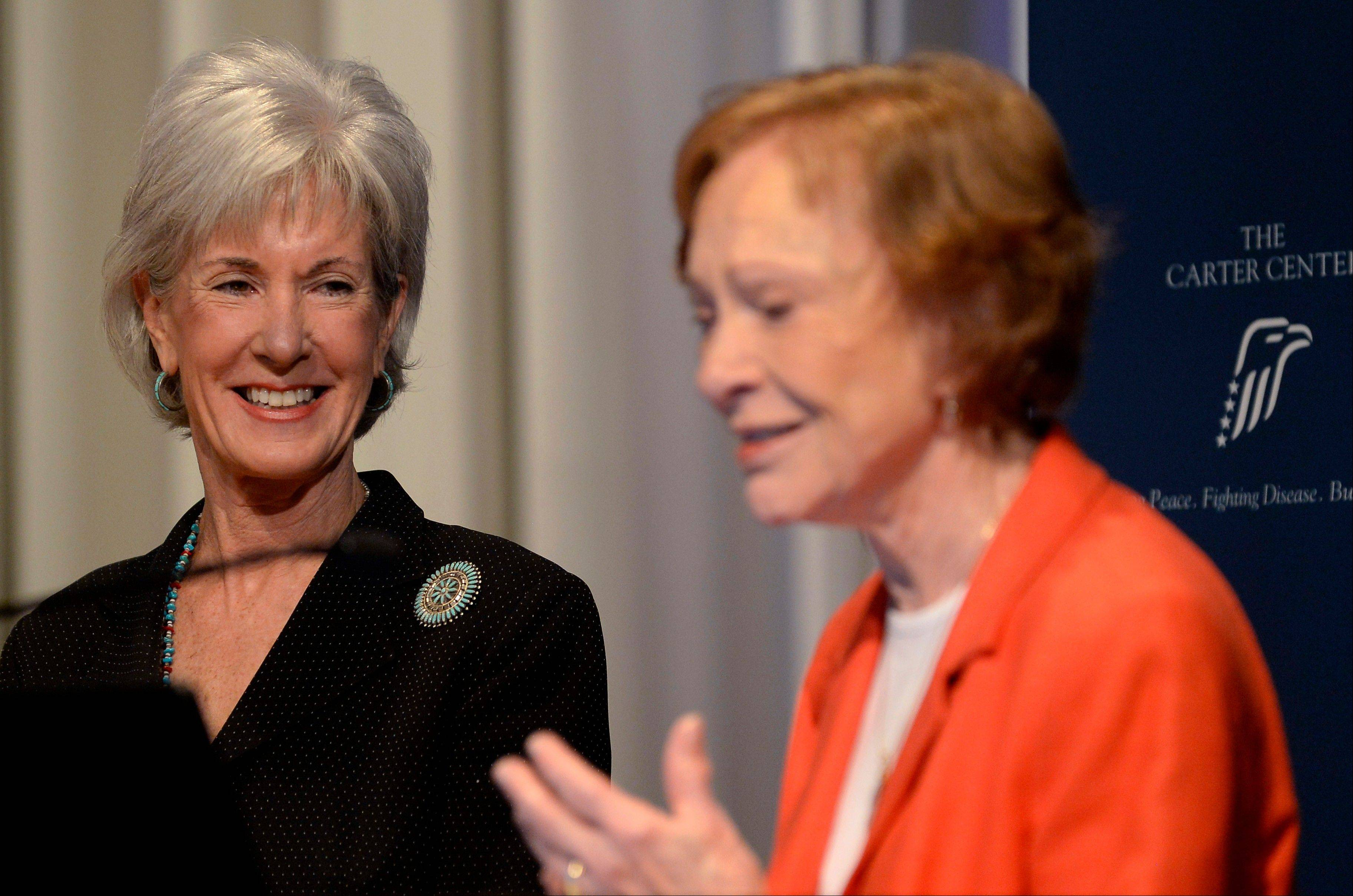 Department of Health and Human Services Secretary Kathleen Sebelius smiles Friday as she is thanked by Former First Lady Rosalynn Carter after announcing easier access to mental health care during Carter's 29th annual mental health policy symposium at the Carter Center in Atlanta.